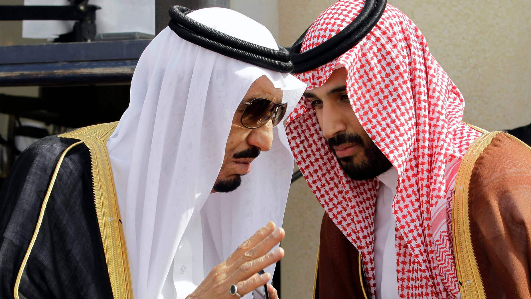 May 12, 2012:Tthen Crown Prince Salman bin Abdul-Aziz Al Saud, left, speaks with his son Prince Mohammed as they wait for Gulf Arab leaders ahead of the opening of Gulf Cooperation Council, also known as GCC summit, in Riyadh, Saudi Arabia.
