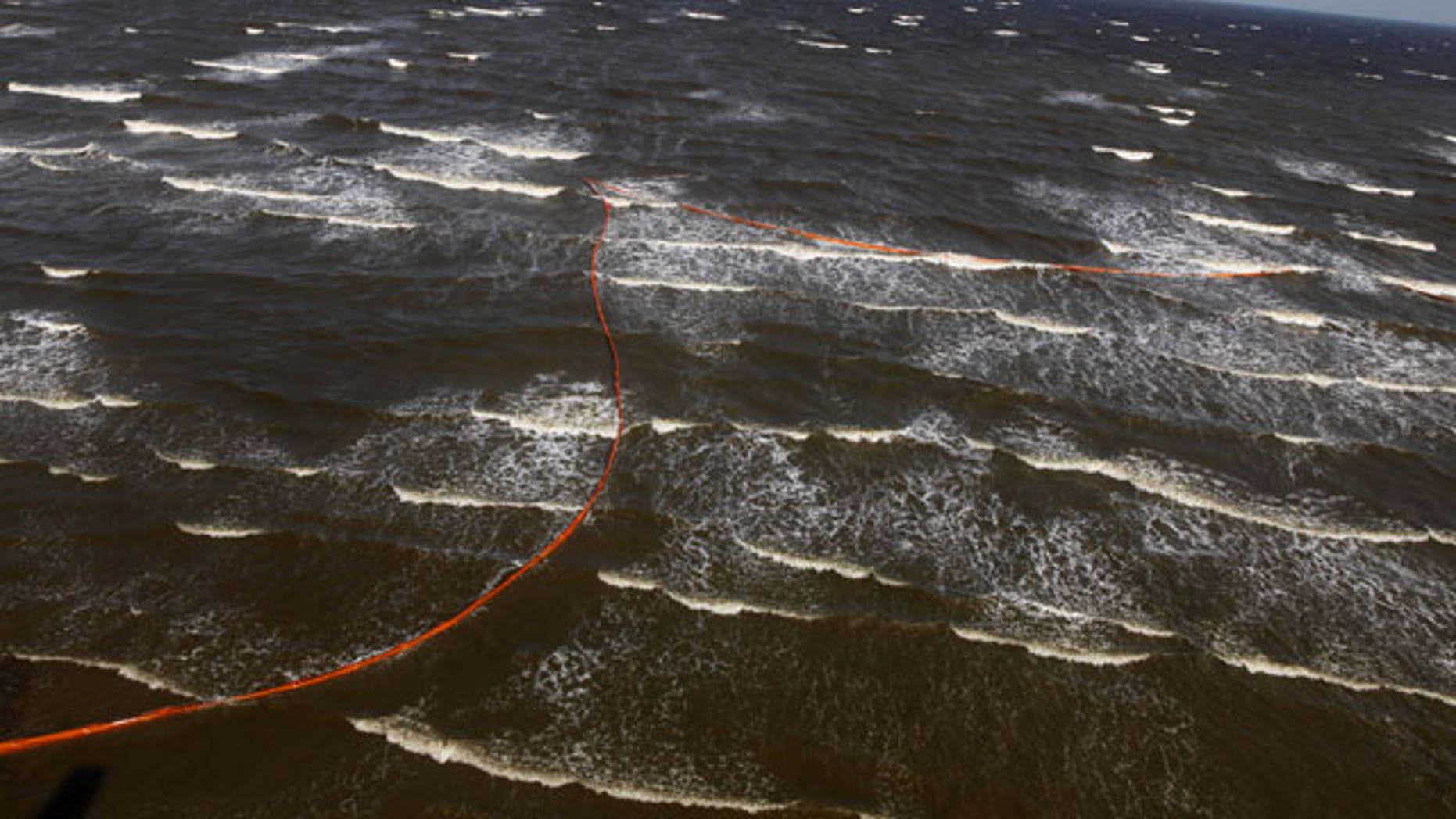 April 29: Oil booms that were placed in preparation of the looming oil spill from last week's collapse and spill of the Deepwater Horizon oil rig are seen strewn along the shoreline from choppy seas in Port Eads, La.