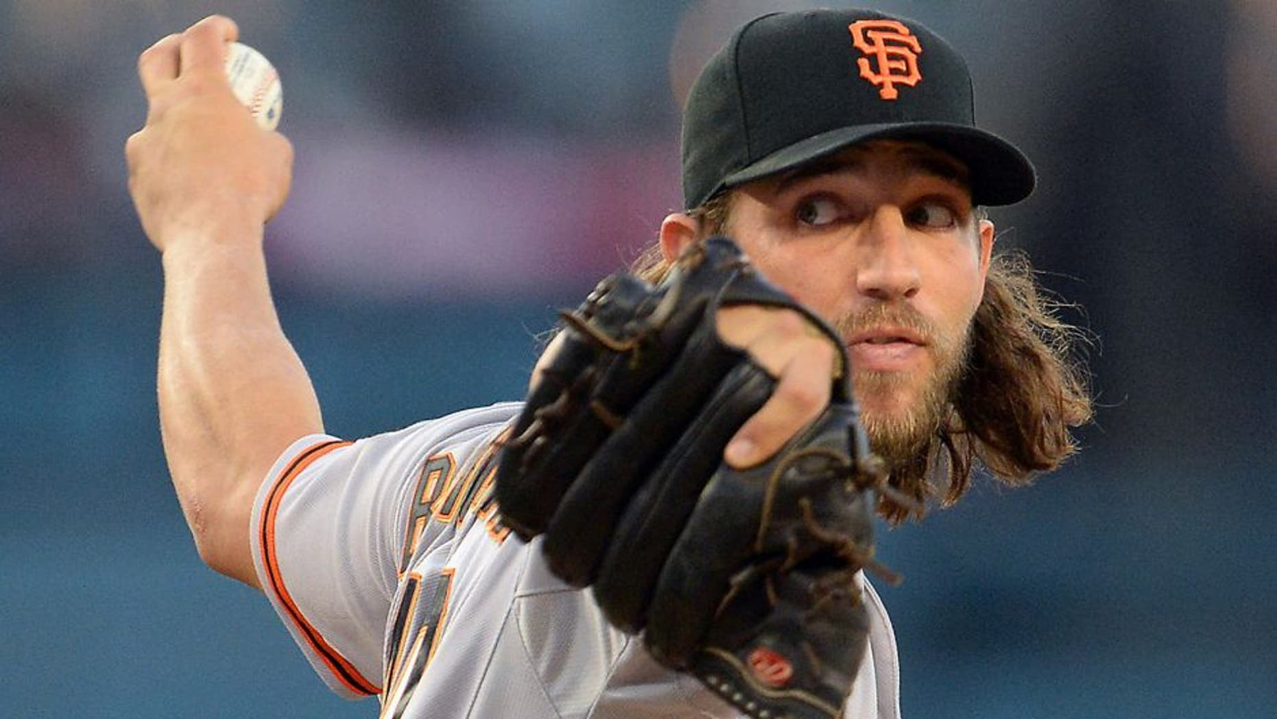 Apr 28, 2015; Los Angeles, CA, USA; San Francisco Giants starting pitcher Madison Bumgarner (40) throws in the first inning against the Los Angeles Dodgers at Dodger Stadium. Mandatory Credit: Jayne Kamin-Oncea-USA TODAY Sports