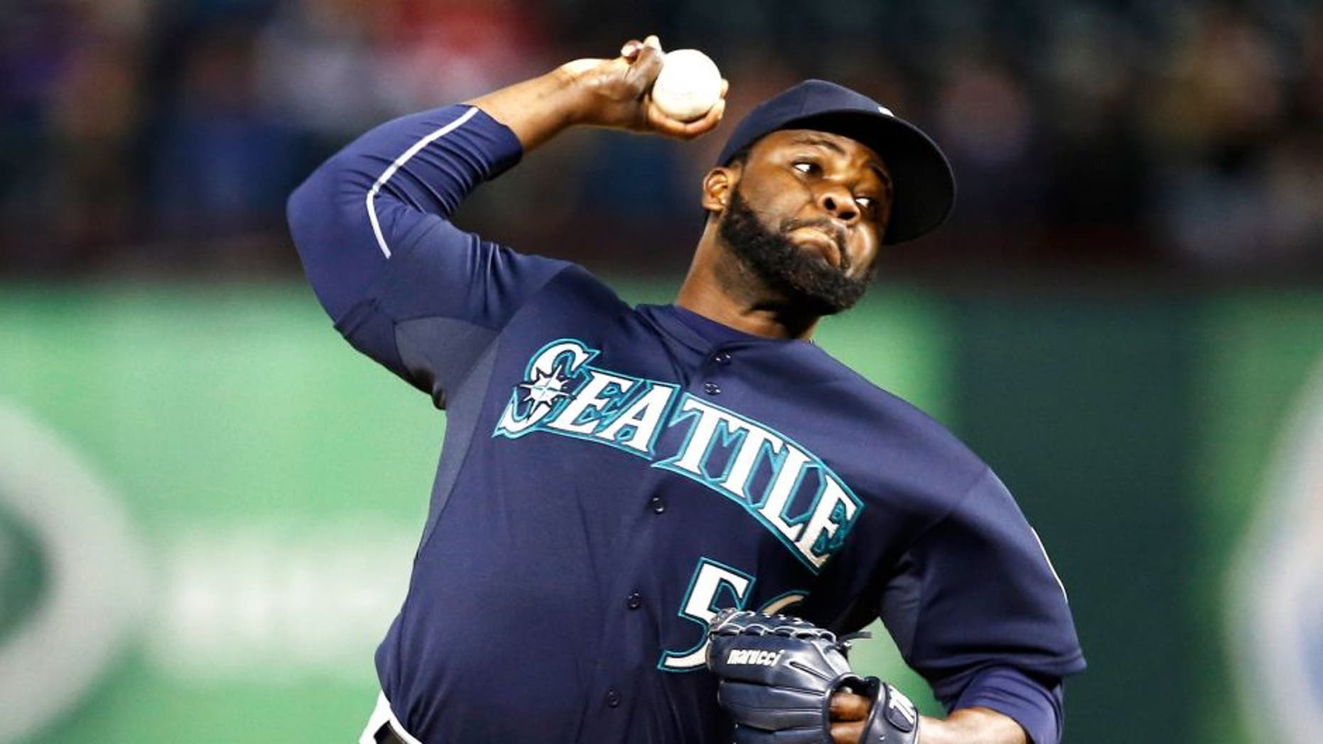 Apr 28, 2015; Arlington, TX, USA; Seattle Mariners relief pitcher Fernando Rodney (56) delivers a pitch to the Texas Rangers during the ninth inning of a baseball game at Globe Life Park in Arlington. The Mariners won 2-1. Mandatory Credit: Jim Cowsert-USA TODAY Sports