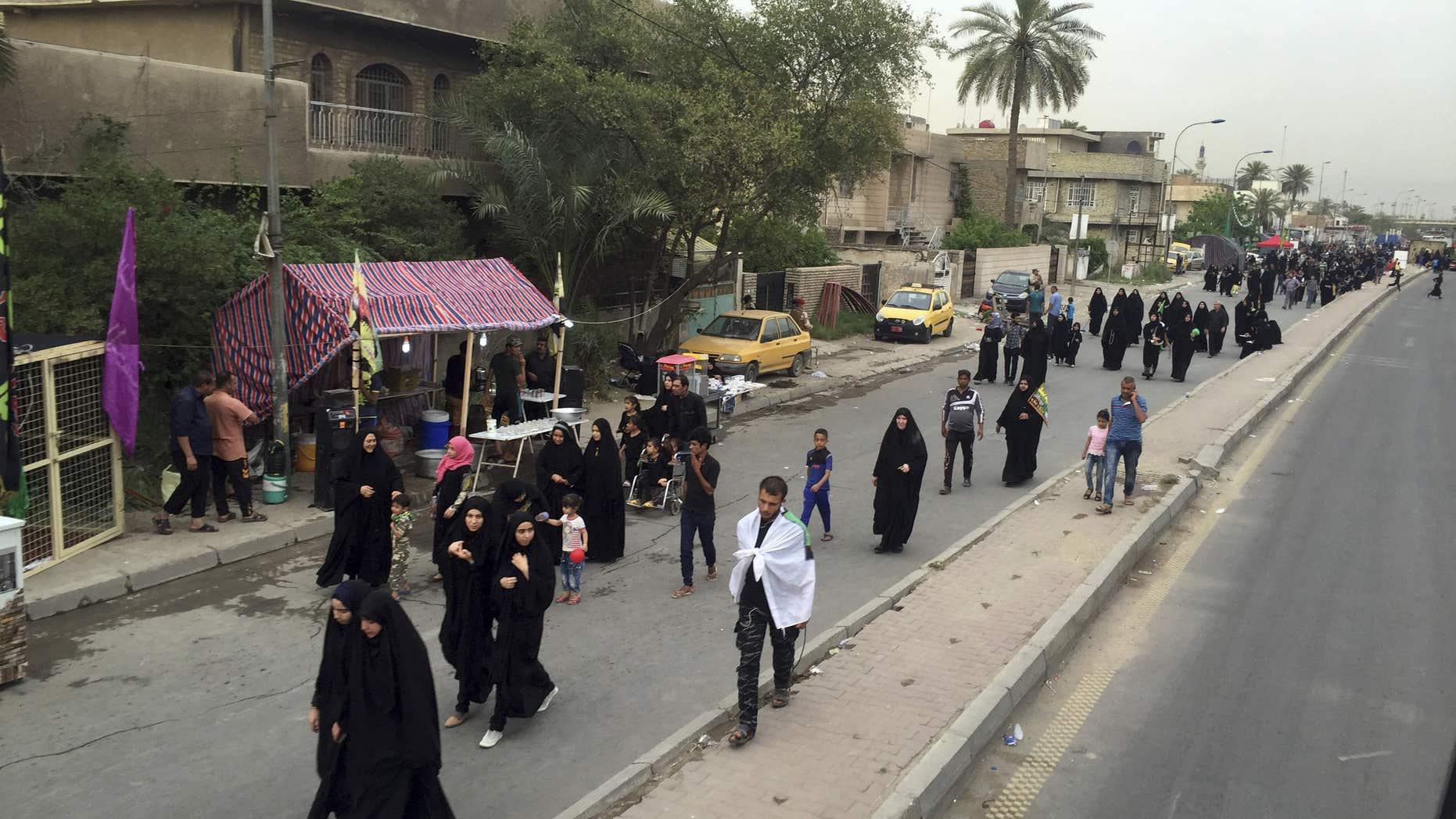 April 29, 2016: Shiite pilgrims march toward the Imam Mousa al-Kadhim shrine to commemorate the anniversary of the Imam's death in Baghdad, Iraq.