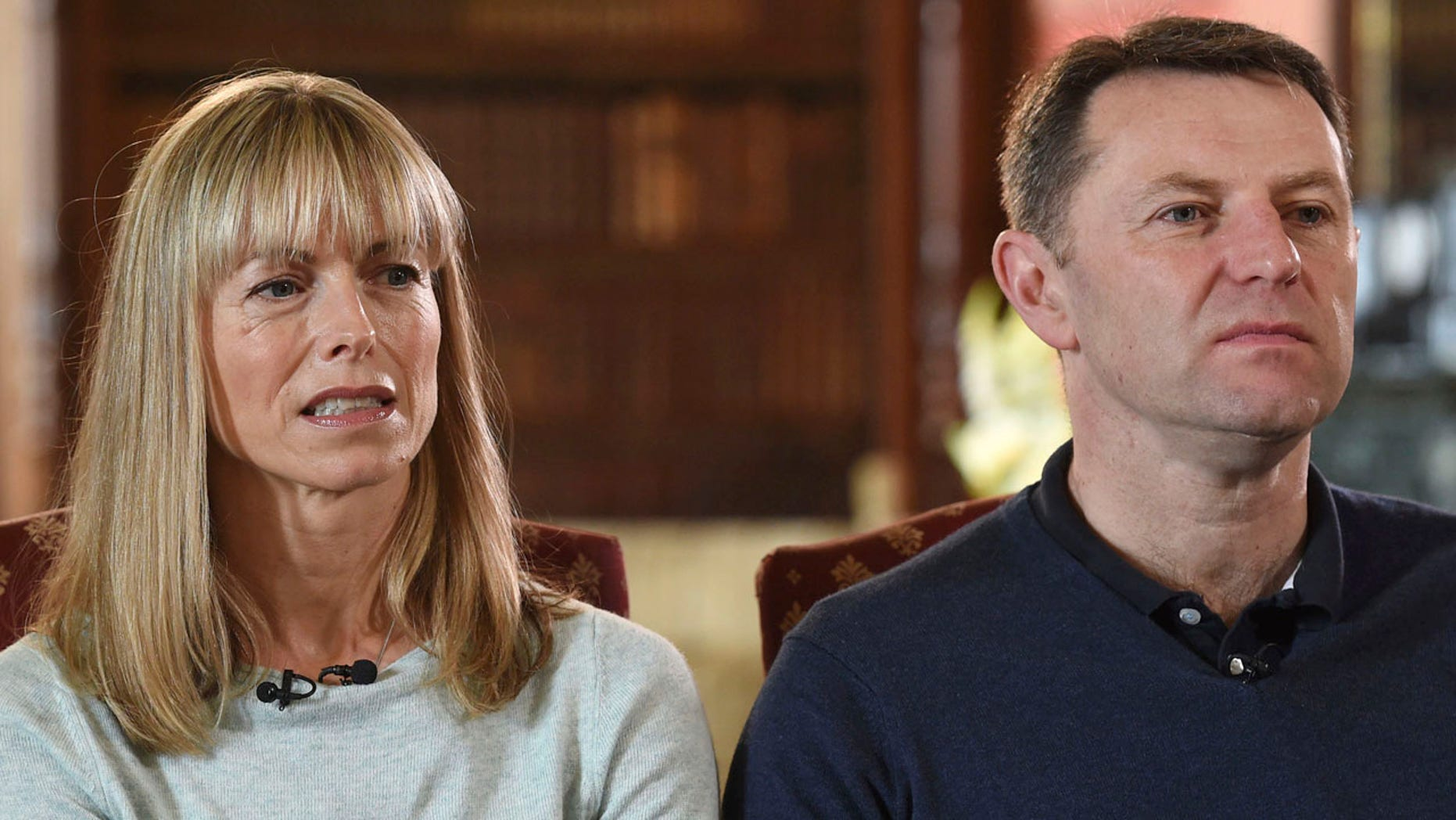 Kate and Gerry McCann, whose daughter Madeleine disappeared from a holiday flat in Portugal ten-years ago, react during a BBC TV interview in Loughborough, England, Friday April 28, 2017.