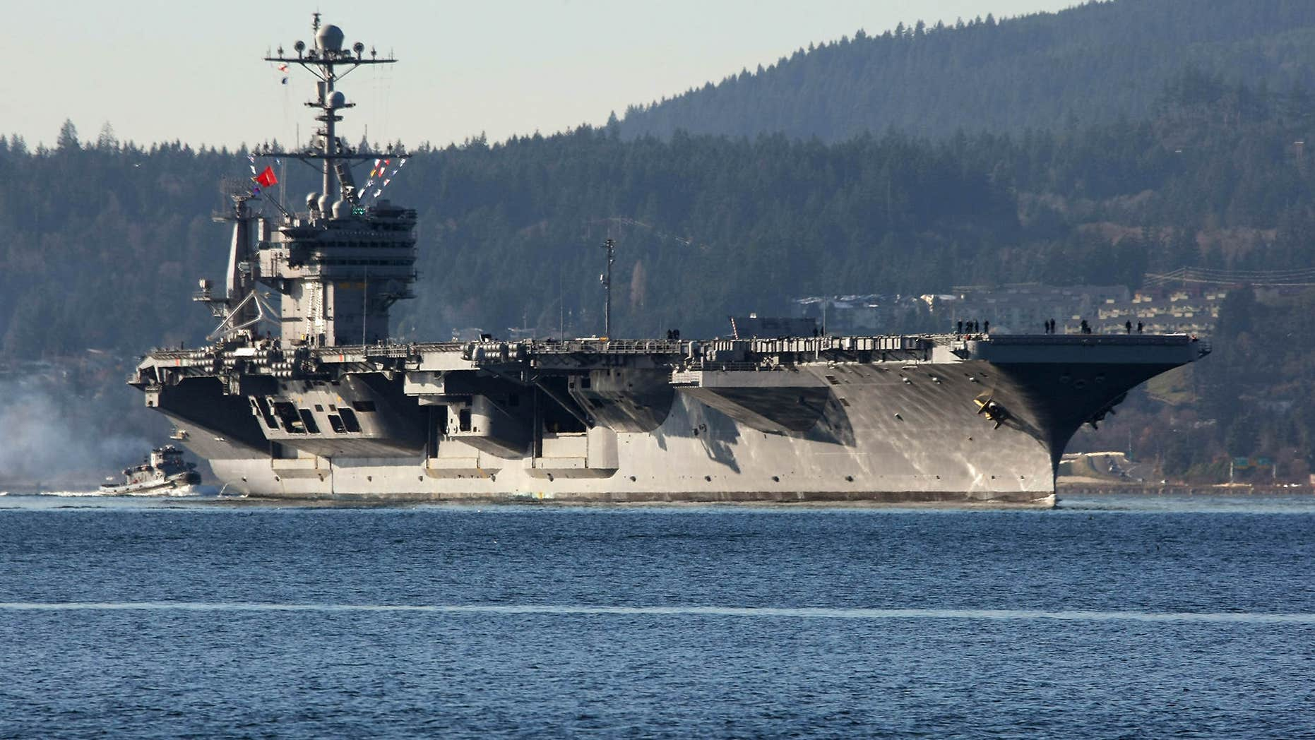 Dec. 1, 2014: FILE - In this photo Dec. 1, 2014 file photo, the aircraft carrier USS John Stennis seen near Bremerton, Wash.