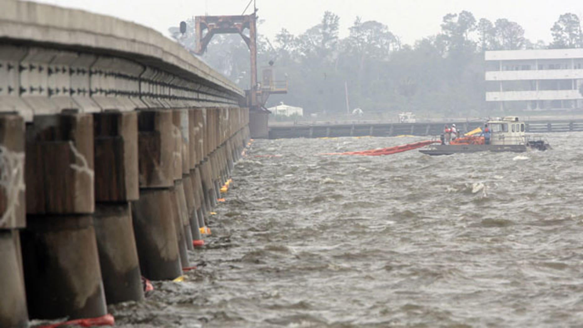 April 30: Workers spread oil booms along a railroad trestle that crosses the bay in Bay St. Louis, Miss., as preparations continue to head off damage from an inpending oil spill along the Gulf coast.