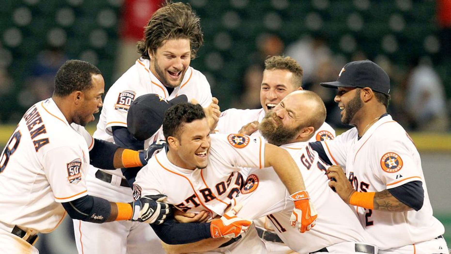 Apr 30, 2015; Houston, TX, USA; Houston Astros players celebrate Houston Astros second baseman Jose Altuve (27) game-winning RBI hit against the Seattle Mariners in the bottom of the 10th inning at Minute Maid Park. Mandatory Credit: Thomas B. Shea-USA TODAY Sports