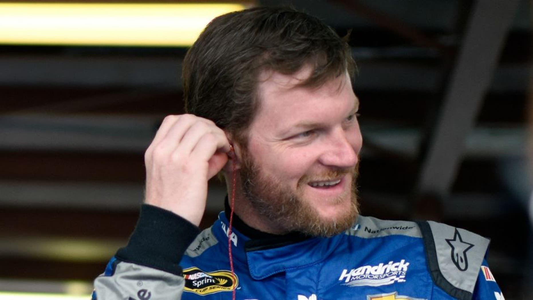 during practice for the NASCAR Sprint Cup Series GEICO 500 at Talladega Superspeedway on April 29, 2016 in Talladega, Alabama.,TALLADEGA, AL - APRIL 29: Dale Earnhardt Jr, driver of the #88 Nationwide Chevrolet, stands in the garage area during practice for the NASCAR Sprint Cup Series GEICO 500 at Talladega Superspeedway on April 29, 2016 in Talladega, Alabama. (Photo by Jared C. Tilton/Getty Images)