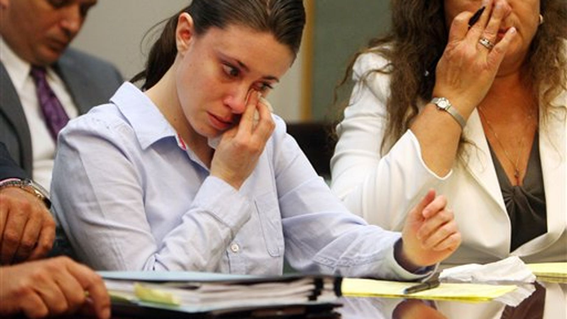 Aug. 21, 2009: Casey Anthony wipes tears from her eyes after seeing her father George Anthony testify during a court hearing in Orlando, Fla.