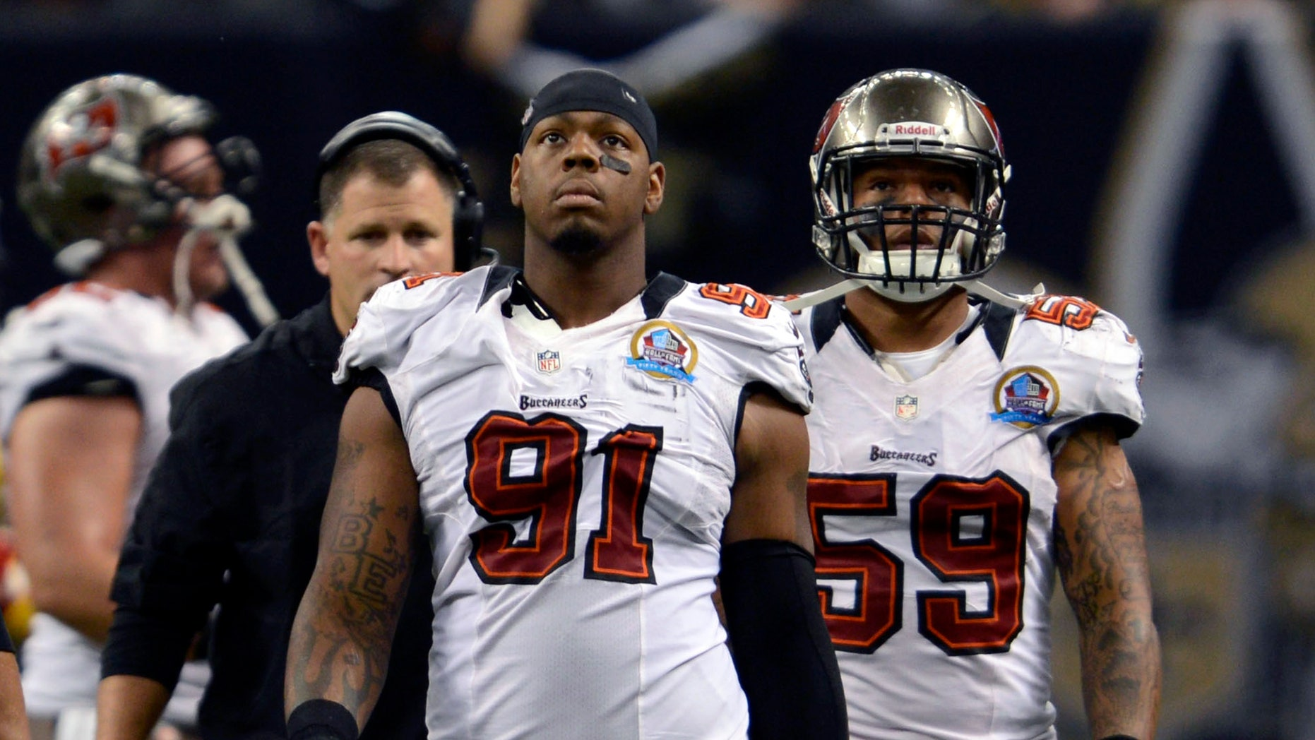 FILE - In this Dec. 16, 2012, file photo, Tampa Bay Buccaneers defensive end Da'Quan Bowers (91) walks off the field during an NFL football game in New Orleans. Bowers was arrested at LaGuardia Airport in New York on Monday, Feb. 18, 2013, after police found a loaded handgun in his luggage, according to authorities. (AP Photo/Bill Feig, File)