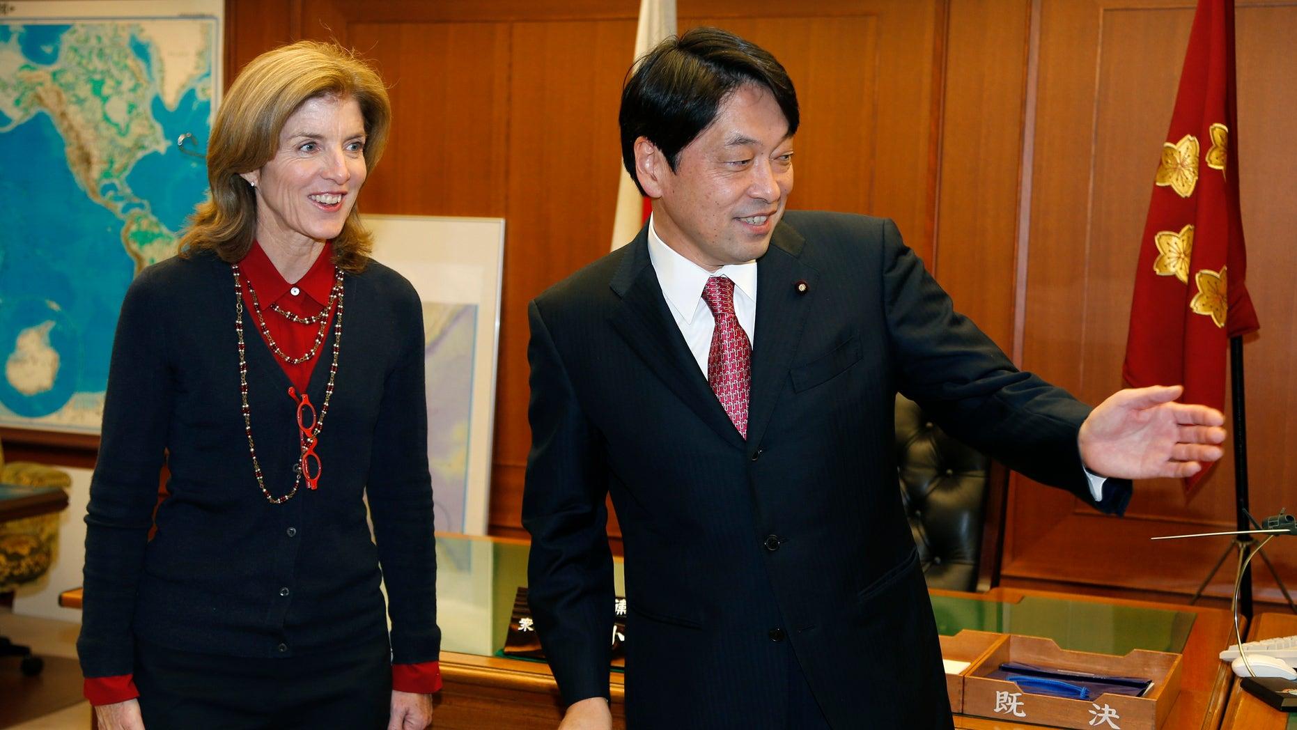 New U.S. Ambassador to Japan Caroline Kennedy is greeted by Japanese Defense Minister Itsunori Onodera at the start of their meeting at Japan's Defense Ministry in Tokyo, Thursday, Nov. 21, 2013. (AP Photo/Shizuo Kambayashi)