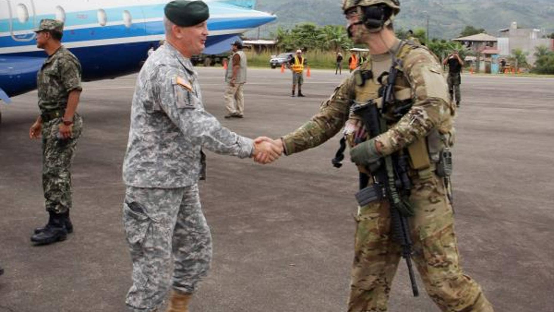 (Left) Army Brig. Gen. Sean P. Mulholland, the commander of Special Operations Command South, greets U.S. servicemembers May 7 to Lima, Peru. During his visit to the region, Mulholland spoke with Peruvian military commanders to discuss a range of topics including military collaboration, improving regional security as well as observing an ongoing U.S.-Peruvian military exercise. As the special operations component for U.S. Southern Command (USSOUTHCOM), SOCSOUTH, headquartered at Homestead Air Reserve Base, Fla., assists special operations partners across Central and South America and the Caribbean to build its military capacity. (Department of Defense photo by Army Maj. Emanuel Ortiz, Special Operations Command South Public Affairs Office)