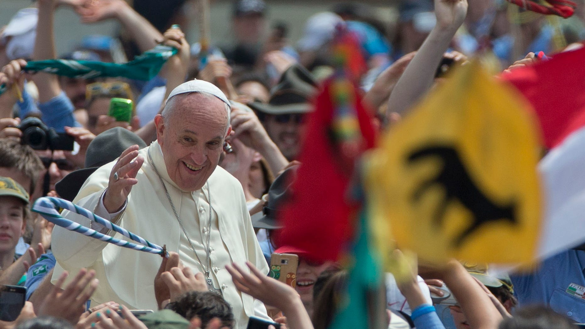 Pope Francis is cheered by the crowd as he arrives for an audience with Italian AGESCI boy scouts association's members in St. Peter's Square at the Vatican, Saturday, June 13, 2015. (AP Photo/Alessandra Tarantino)