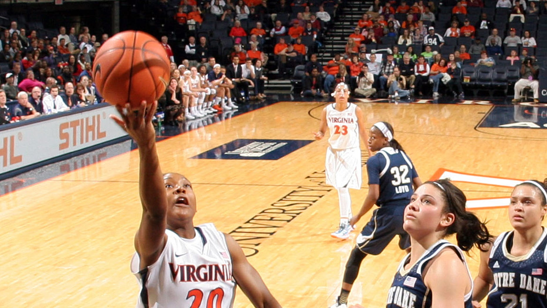 Virginia guard Faith Randolph (20) shoots next to Notre Dame forward Natalie Achonwa during the first half of an NCAA college basketball game on Sunday, Jan. 12, 2014, in Charlottesville, Va. Notre Dame defeated Virginia  79-72. (AP Photo/Andrew Shurtleff)