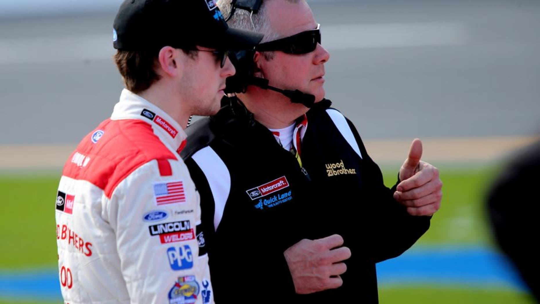 DAYTONA BEACH, FL - FEBRUARY 14: Ryan Blaney, driver of the #21 Motorcraft/Quick Lane Tire & Auto Center Ford, talks with crew chief Jeremy Bullins on the grid during qualifying for the NASCAR Sprint Cup Series Daytona 500 at Daytona International Speedway on February 14, 2016 in Daytona Beach, Florida. (Photo by Jerry Markland/Getty Images)