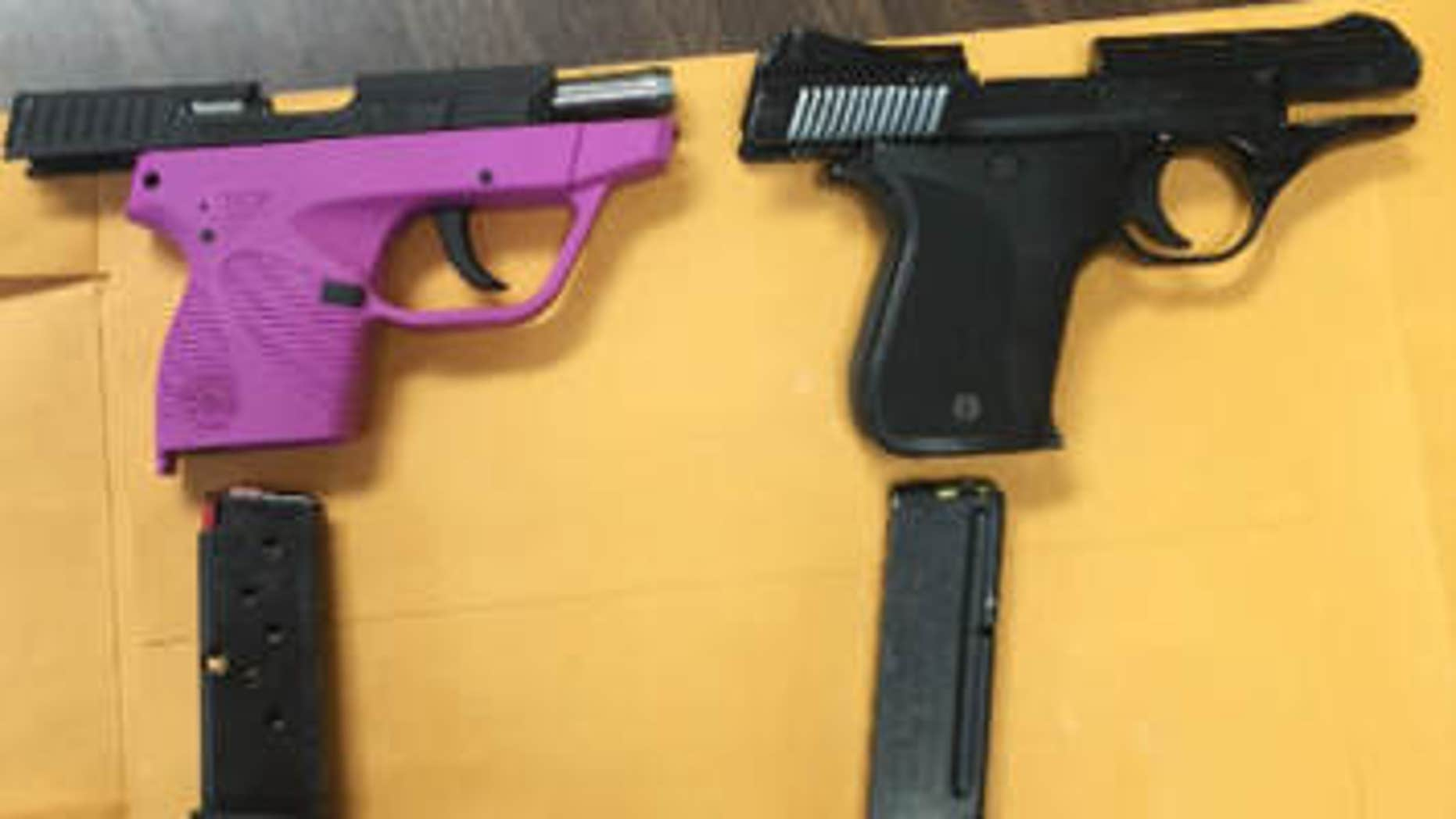 April 30, 2015: In this photo provided by Kentucky State Police, handguns sit on a table.