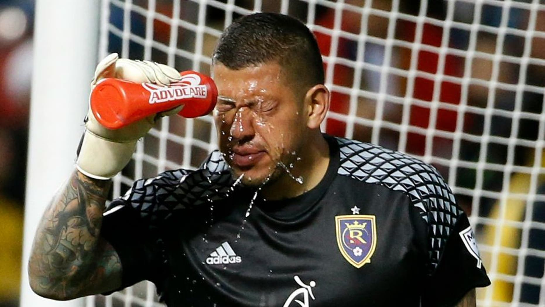 Apr 30, 2016; Sandy, UT, USA; Real Salt Lake goalkeeper Nick Rimando (18) cools down after taking a ball to the face in the second half against the Houston Dynamo at Rio Tinto Stadium. Real Salt Lake defeated Houston Dynamo 2-1. Mandatory Credit: Jeff Swinger-USA TODAY Sports