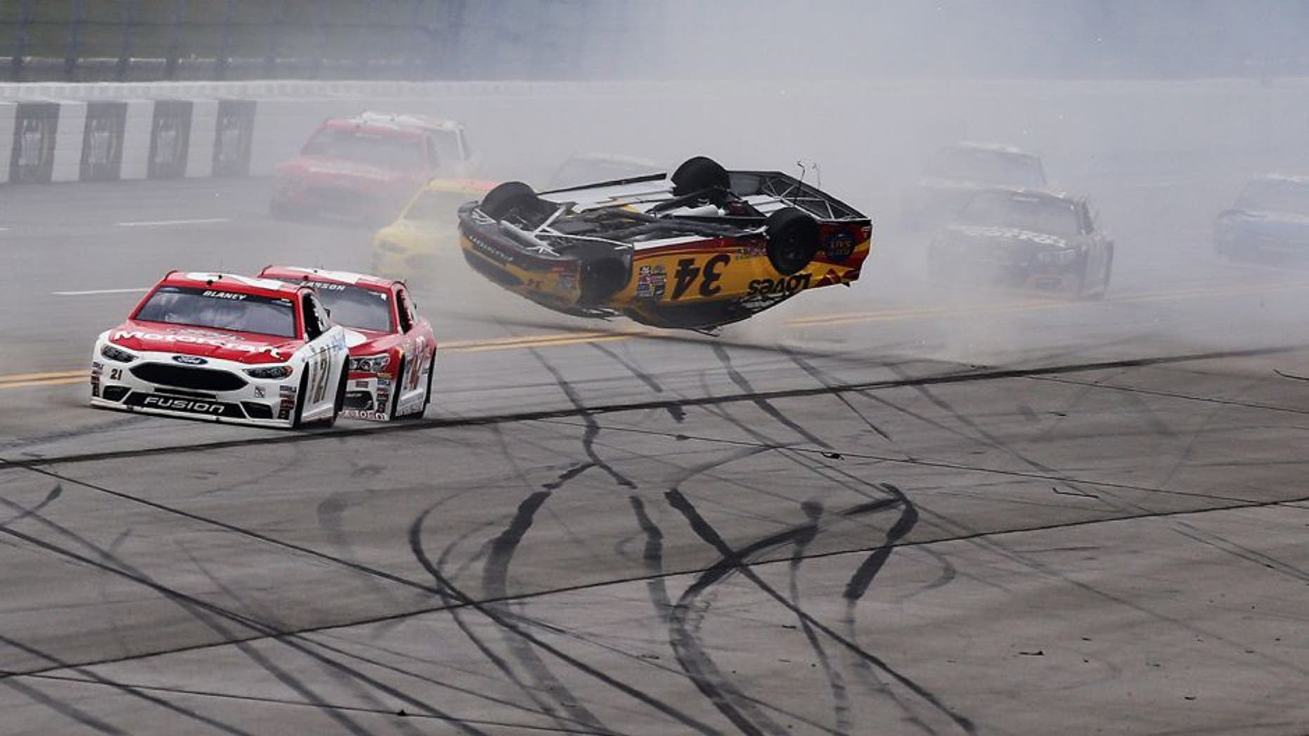 TALLADEGA, AL - MAY 01: Chris Buescher, driver of the #34 Love's Travel Stops/CSX-Play it Safe Ford, has an on track incident during the NASCAR Sprint Cup Series GEICO 500 at Talladega Superspeedway on May 1, 2016 in Talladega, Alabama. (Photo by Jerry Markland/Getty Images)