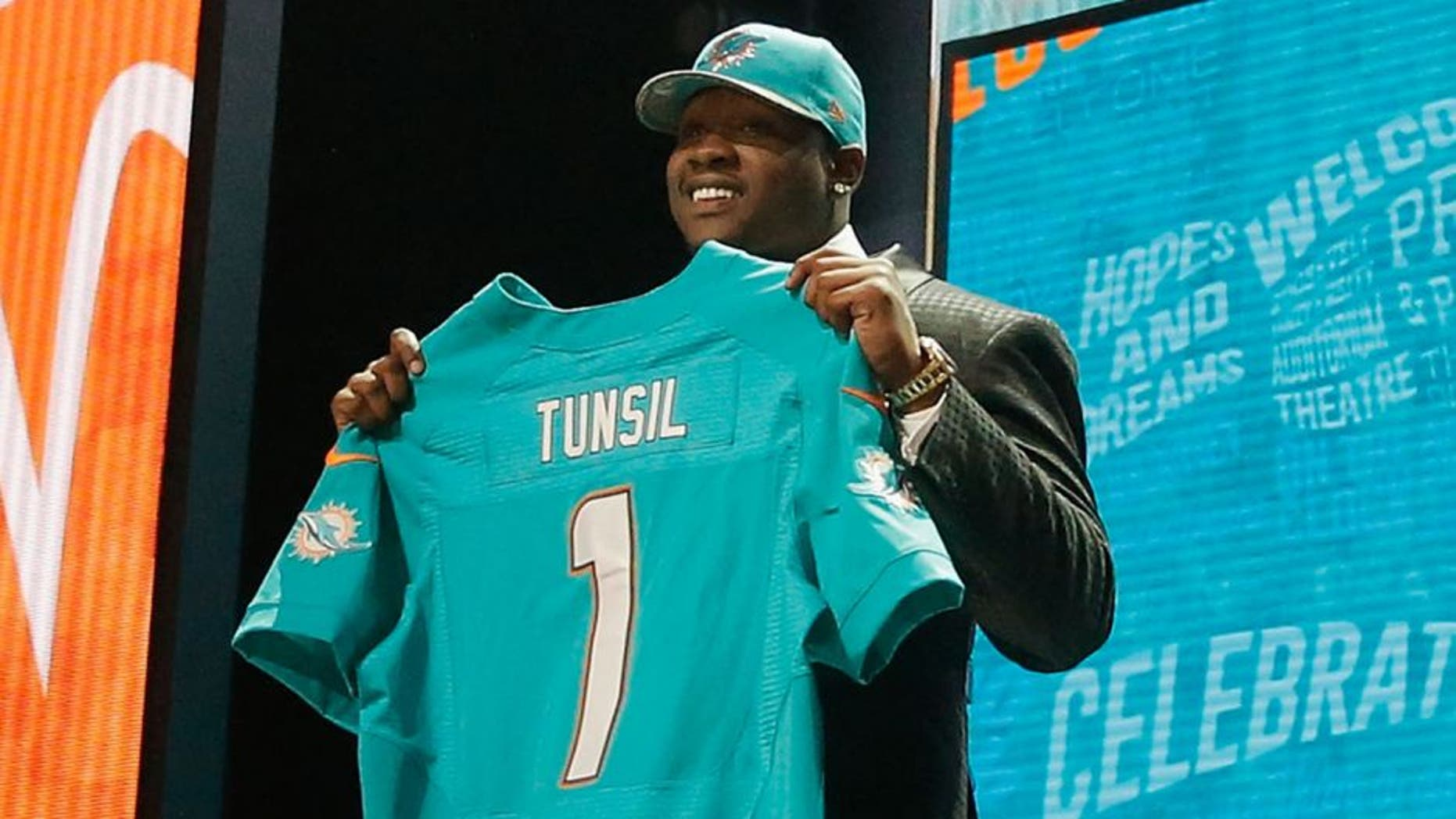 CHICAGO, IL - APRIL 28: Laremy Tunsil of Ole Miss holds up a jersey after being picked #13 overall by the Miami Dolphins during the first round of the 2016 NFL Draft at the Auditorium Theatre of Roosevelt University on April 28, 2016 in Chicago, Illinois. (Photo by Jon Durr/Getty Images)