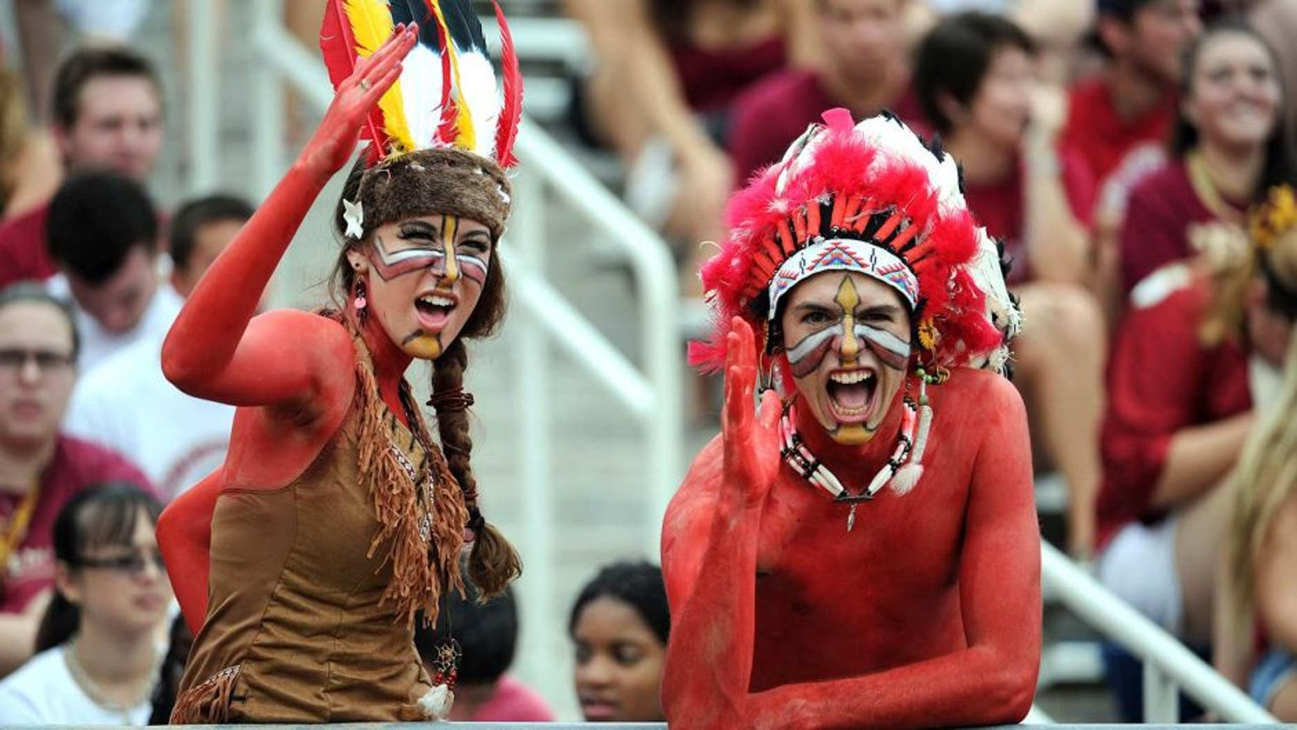Sept 8, 2012; Tallahassee, Florida, USA; Florida State Seminoles fans cheer during the game against the Savannah State Tigers at Doak Campbell Stadium. Mandatory Credit: Melina Vastola-USA TODAY Sports