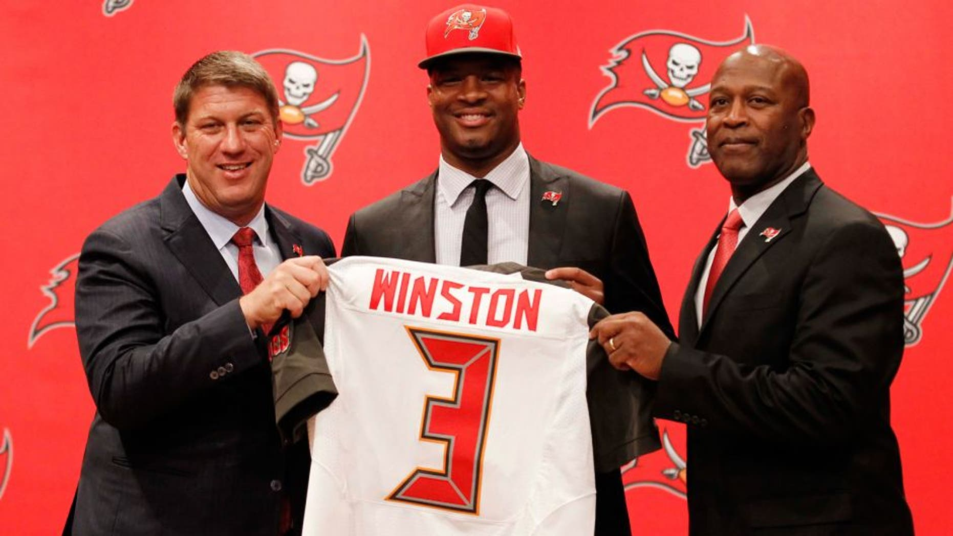 May 1, 2015; Tampa, FL, USA; Tampa Bay Buccaneers quarterback Jameis Winston (3), the number one overall draft pick, poses with general manager Jason Licht and head coach Lovie Smith for a photo during a press conference at One Buc Place. Mandatory Credit: Kim Klement-USA TODAY Sports