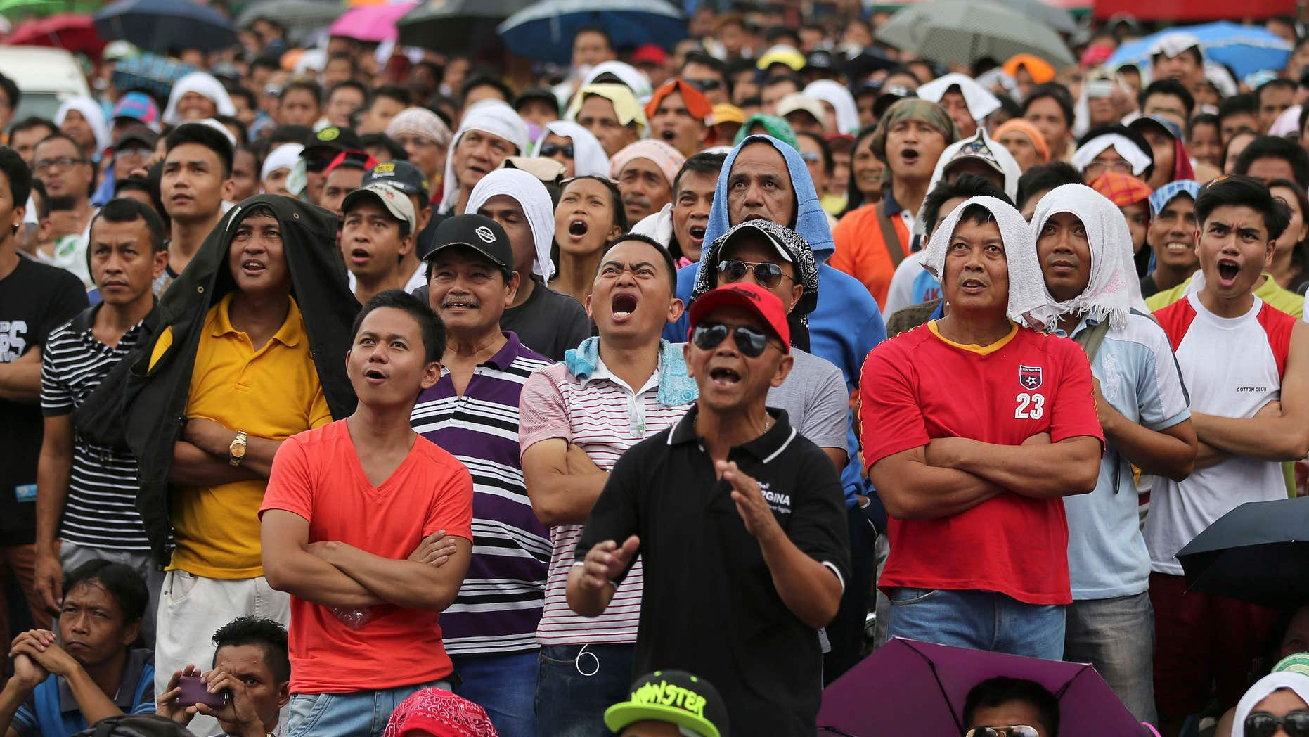 May 3, 2015: Filipinos watch a live satellite feed of the welterweight title fight between Filipino boxing hero Manny Pacquiao and Floyd Mayweather Jr. during a free public viewing in downtown Manila, Philippines.