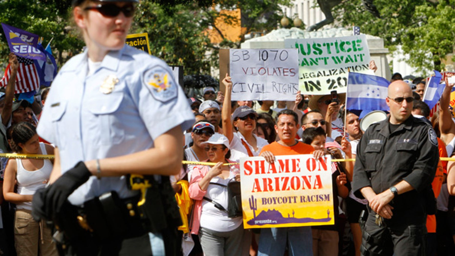 May 1: Protesters hold signs against Arizona's tough new immigration law, near the White House.
