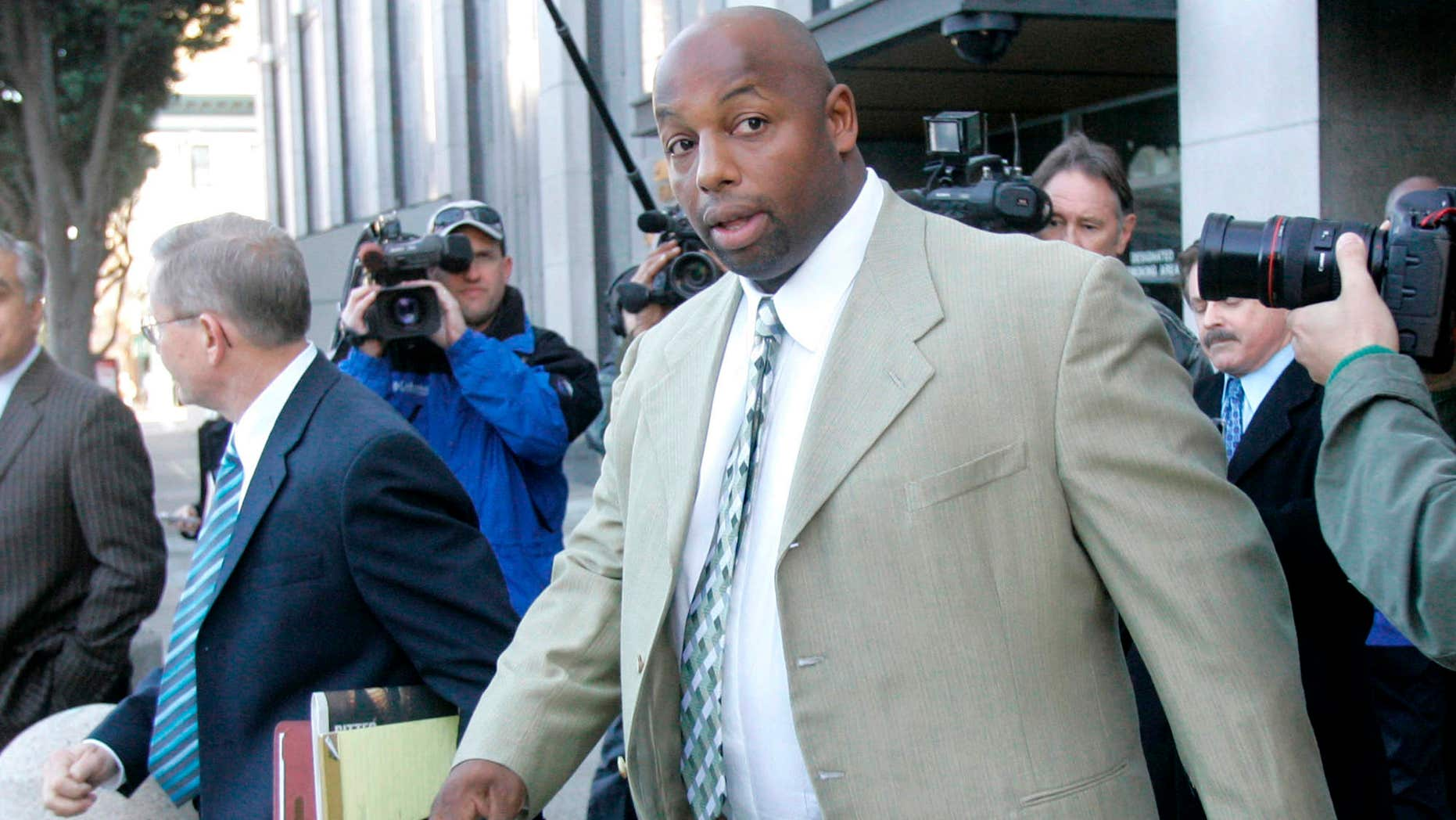 File - In this Jan. 18, 2008 file photo, former NFL football player Dana Stubblefield leaves a federal courthouse in San Francisco.