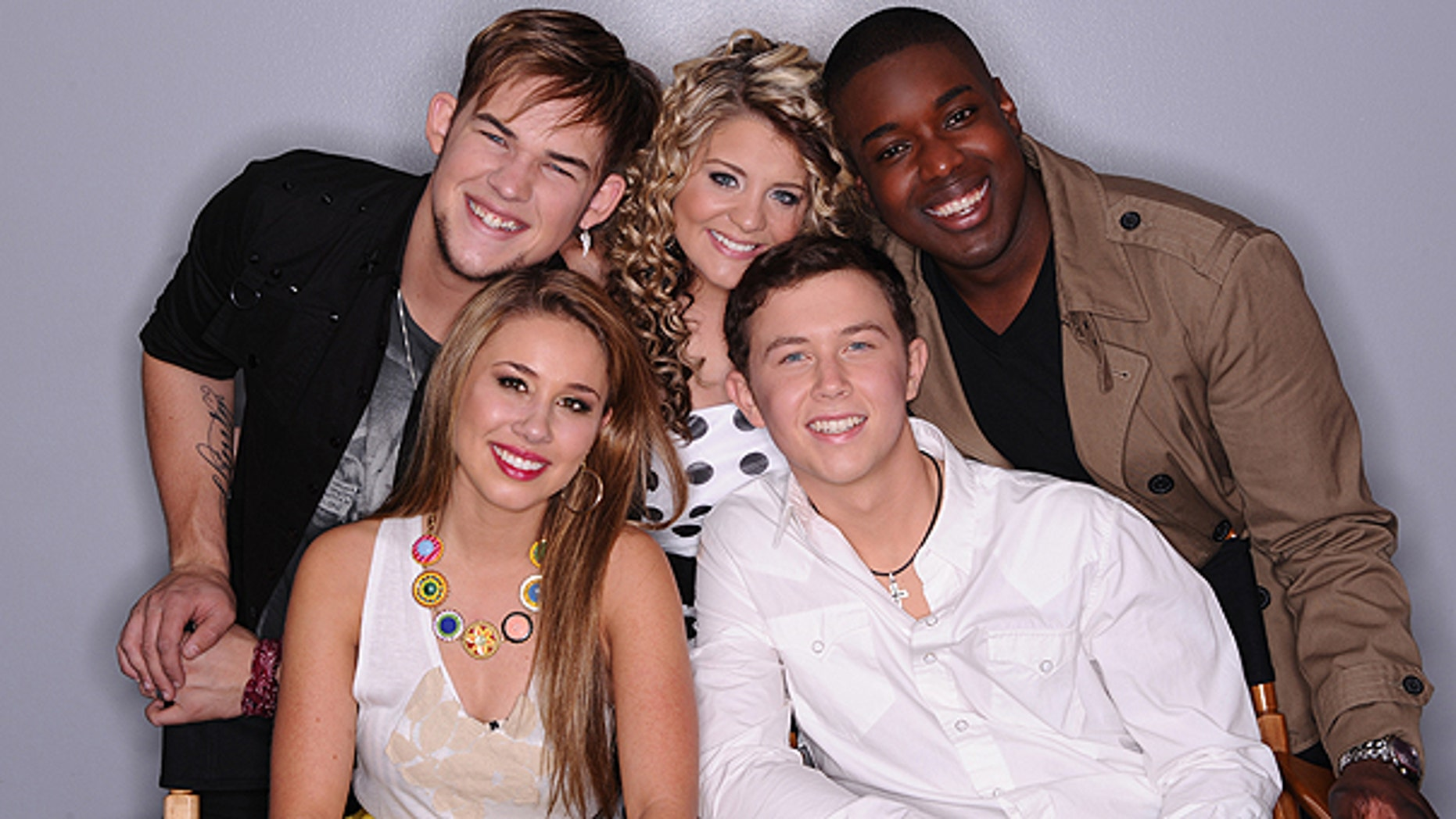 In this April 28, 2011 photo released by FOX, the remaining contestants on the singing competition series, 'American Idol,' clockwise from back row left, James Durbin, Lauren Alaina, Jacob Lusk, Scotty McCreery and Hayley Reinhart are shown in Los Angeles.