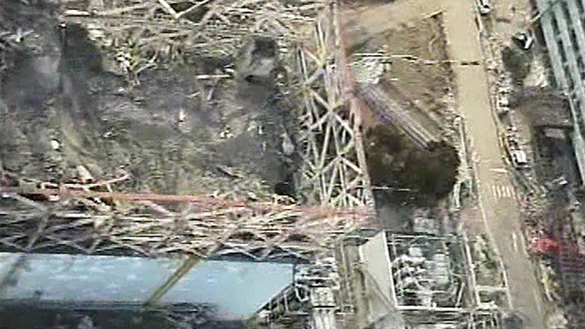 April 10: Image taken by T-Hawk drone aircraft and released by Tokyo Electric Power Co. (TEPCO) shows the damaged reactor building of Unit 1 of the tsunami-crippled Fukushima Dai-ichi nuclear power plant in Okuma, Fukushima Prefecture, northeastern Japan.