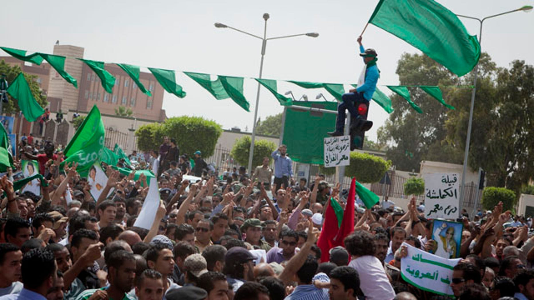 May 2: In this photo made on a government organized tour, supporters attend a funeral ceremony for members of the Qaddafi family in Tripoli, Libya.