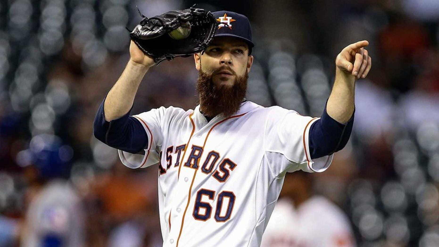 May 4, 2015; Houston, TX, USA; Houston Astros starting pitcher Dallas Keuchel (60) points to first baseman Chris Carter (not pictured) after a play during the fifth inning against the Texas Rangers at Minute Maid Park. Mandatory Credit: Troy Taormina-USA TODAY Sports