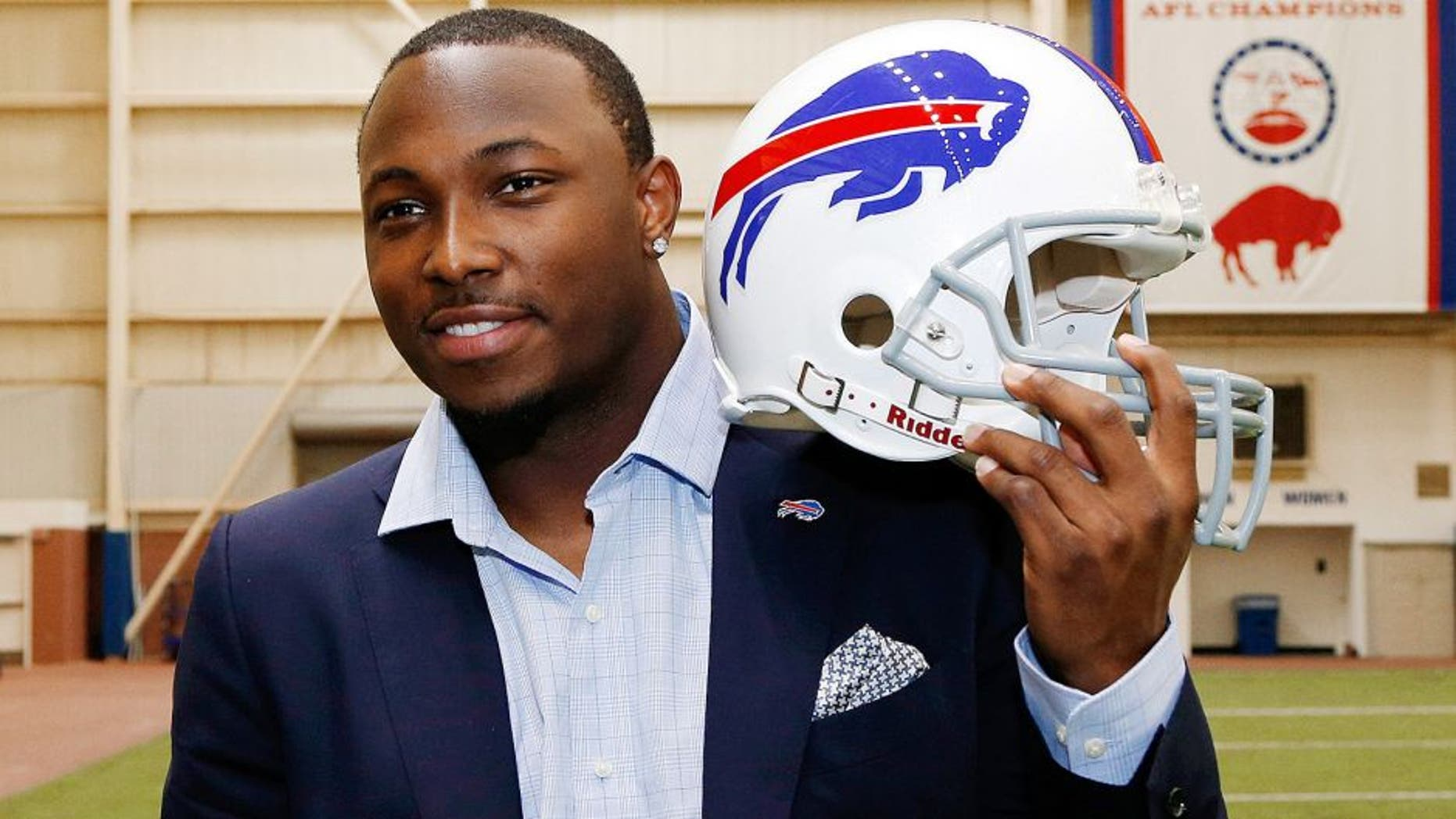 Mar 10, 2015; Orchard Park, NY, USA; Buffalo Bills running back LeSean McCoy poses with a Bills helmet in the AD Pro training facility after a press conference at Ralph Wilson Stadium. Mandatory Credit: Kevin Hoffman-USA TODAY Sports