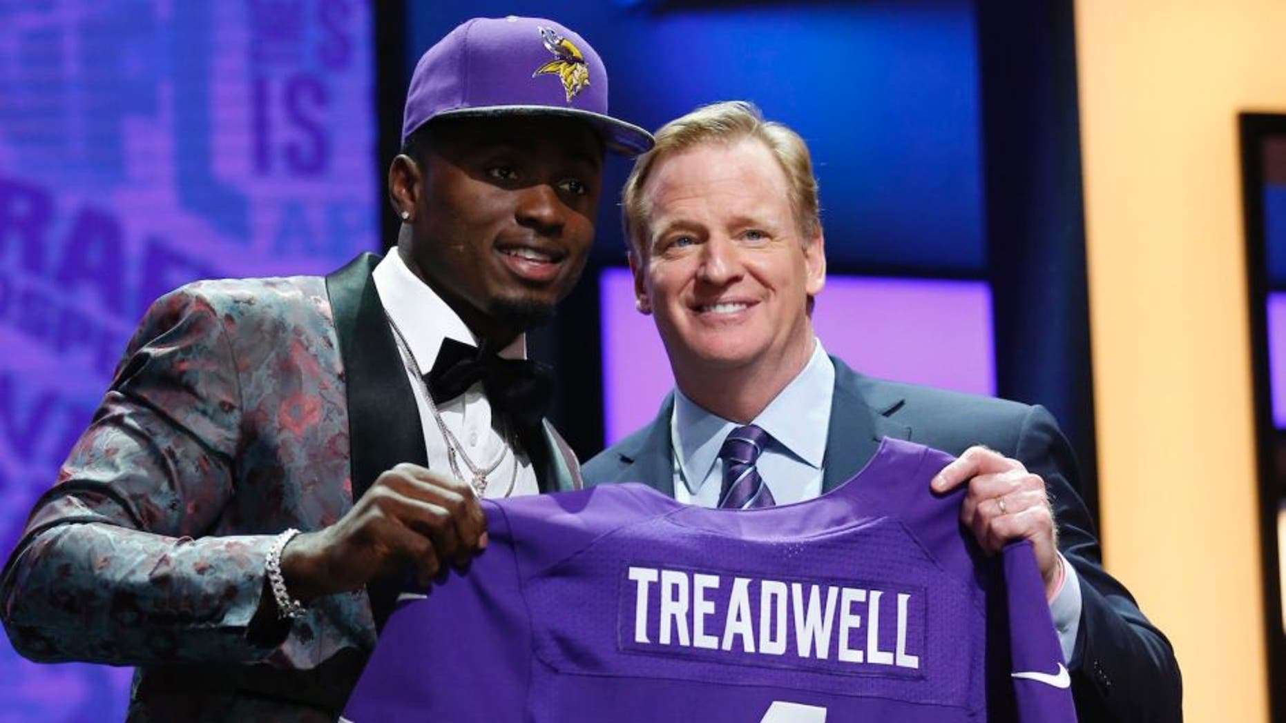 Apr 28, 2016; Chicago, IL, USA; Laquon Treadwell (Mississippi) with NFL commissioner Roger Goodell after being selected by the Minnesota Vikings as the number twenty-three overall pick in the first round of the 2016 NFL Draft at Auditorium Theatre. Mandatory Credit: Kamil Krzaczynski-USA TODAY Sports