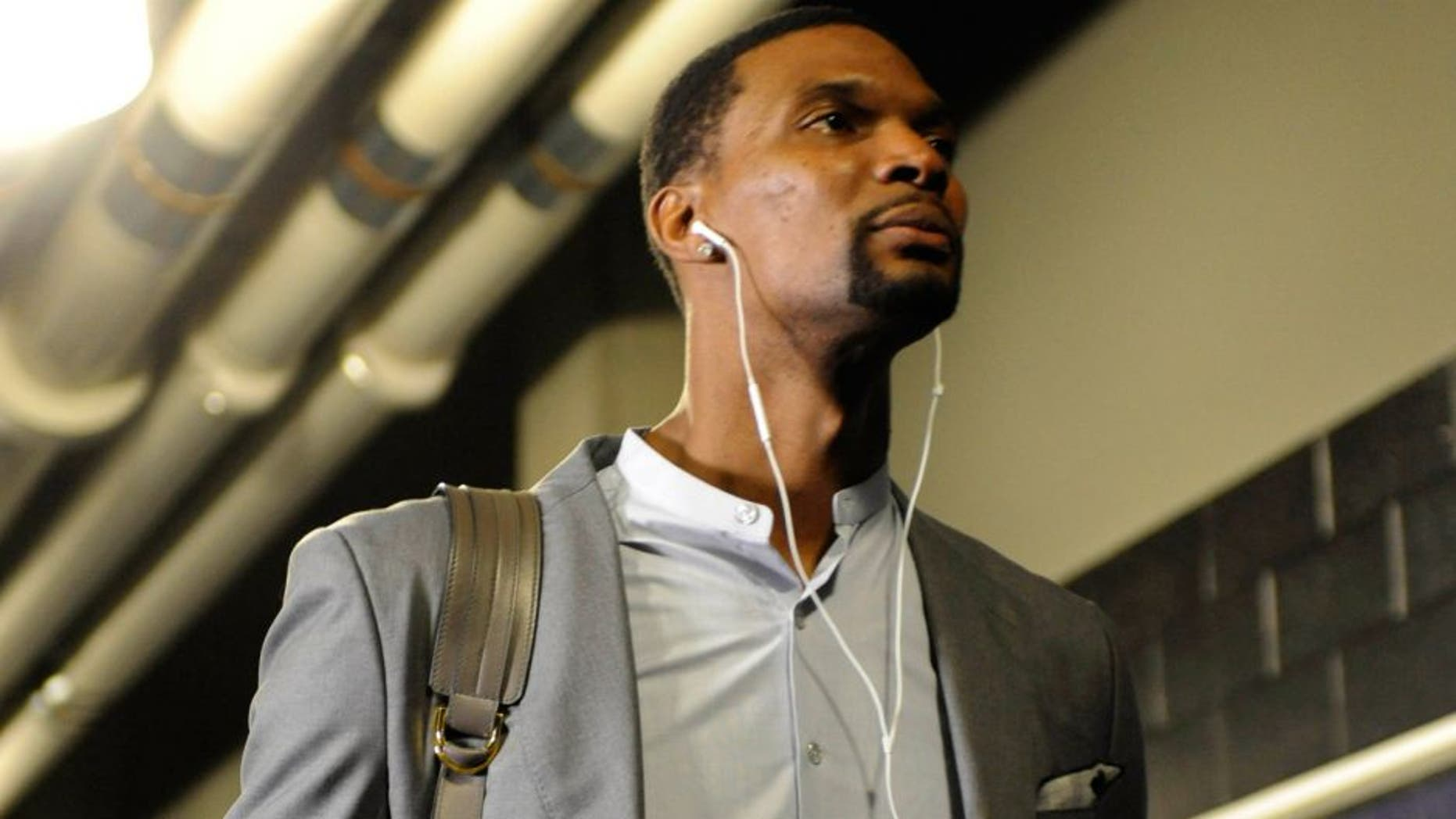 Apr 29, 2016; Charlotte, NC, USA; Miami Heat forward Chris Bosh (1) arrives to to the arena before game six of the first round of the NBA Playoffs against the Charlotte Hornets at Time Warner Cable Arena. Mandatory Credit: Sam Sharpe-USA TODAY Sports