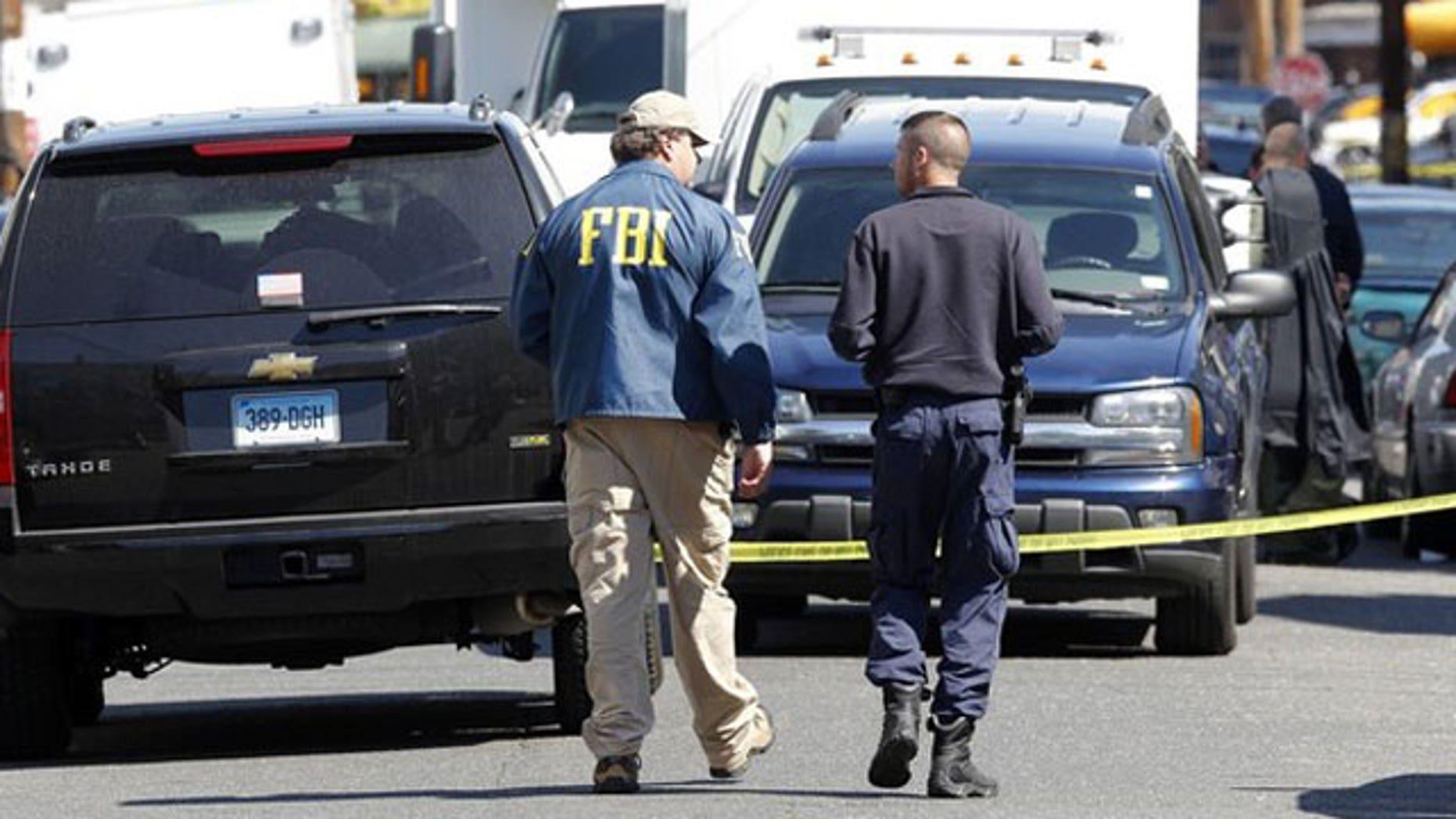 May 4: FBI personnel walk down the street of Pakistani-American Faisal Shahzad on Sheridan Street in Bridgeport, Connecticut.