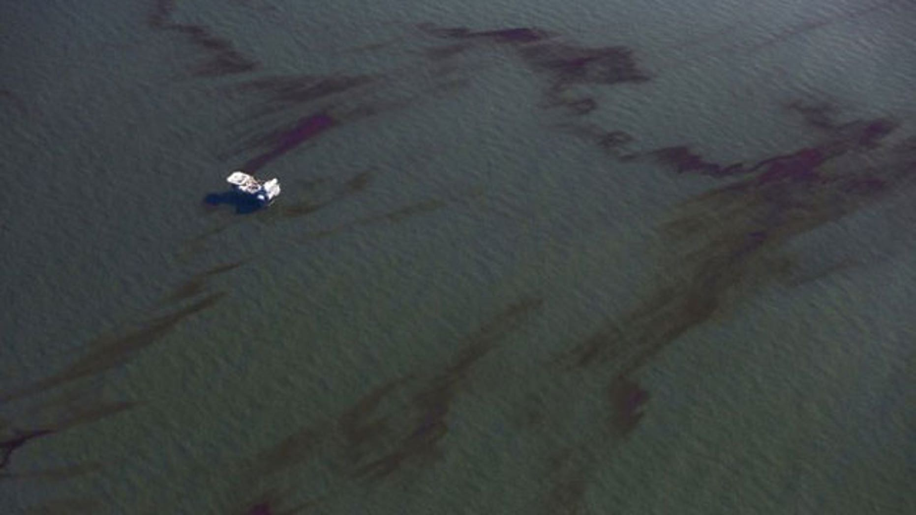 May 5: A platform is surrounded by the oil spill from the Deepwater Horizon wellhead at the mouth of the Mississippi River.