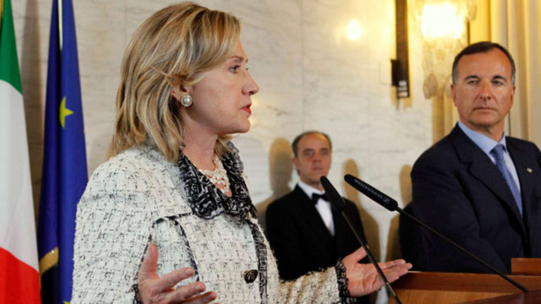 May 5: U.S. Secretary of State Hillary Rodham Clinton, left, speaks to the media with  Italy's Foreign Minister Franco Frattini at the Ministry of Foreign Affairs during the Second Contact Group Meeting on Libya, in Rome.