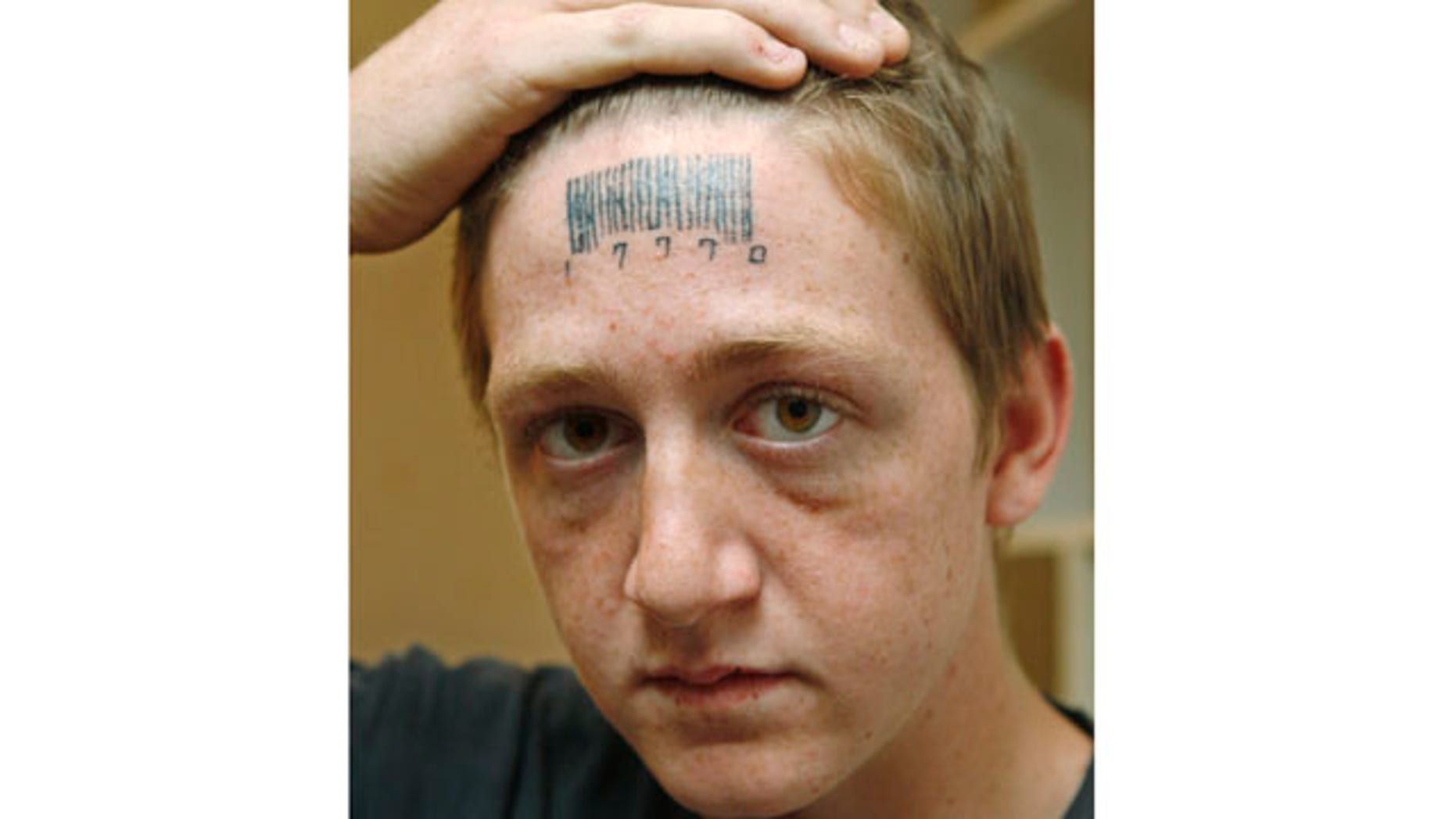 May 4: Stetson Johnson, 18, holds back his hair to show a tattoo on his forehead in his home in Oklahoma City.