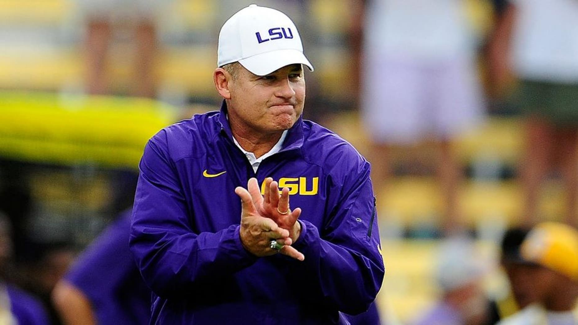 BATON ROUGE, LA - SEPTEMBER 07: Les Miles, head coach of the LSU Tigers, watches his team during warmups prior to a game at Tiger Stadium against the UAB Blazers on September 7, 2013 in Baton Rouge, Louisiana. LSU won the game 56-17. (Photo by Stacy Revere/Getty Images)