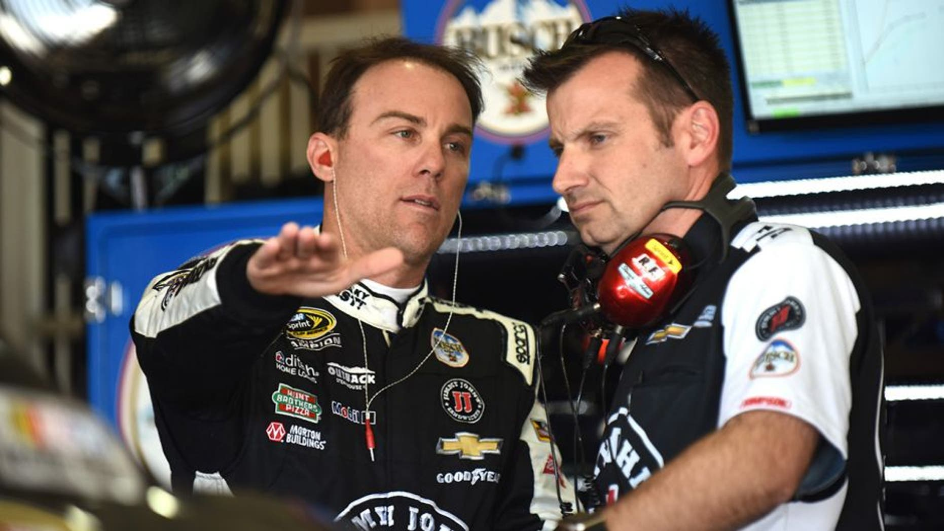 FONTANA, CA - MARCH 18: Kevin Harvick, driver of the #4 Jimmy John's Chevrolet, talks to his crew chief, Rodney Childers, during practice for the NASCAR Sprint Cup Series Auto Club 400 at Auto Club Speedway on March 18, 2016 in Fontana, California. (Photo by Jonathan Moore/Getty Images)