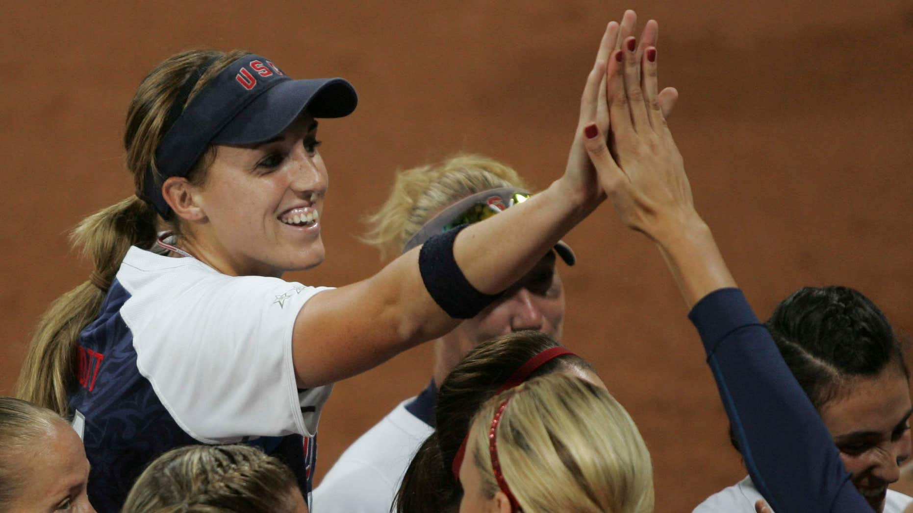 Aug. 17, 2008: Monica Abbott (L) of the U.S. celebrates after pitching a no-hitter against the Netherlands during their women's preliminaries softball game at the Beijing 2008 Olympic Games.