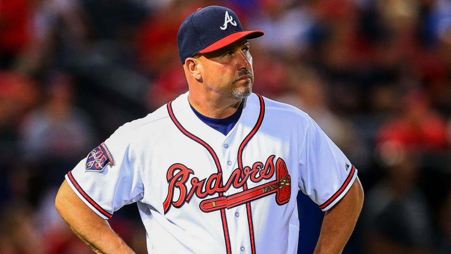 May 5, 2014; Atlanta, GA, USA; Atlanta Braves manager Fredi Gonzalez (33) waits on the field during a replay challenge in the sixth inning against the St. Louis Cardinals at Turner Field. Mandatory Credit: Daniel Shirey-USA TODAY Sports