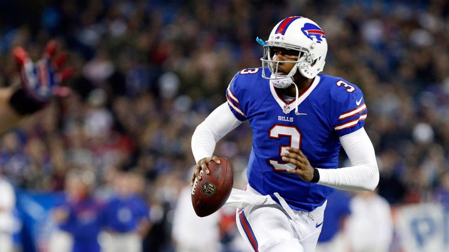 Dec 1, 2013; Toronto, ON, Canada; Buffalo Bills quarterback EJ Manuel (3) rolls out during the first half against the Atlanta Falcons at the Rogers Center. Mandatory Credit: Kevin Hoffman-USA TODAY Sports