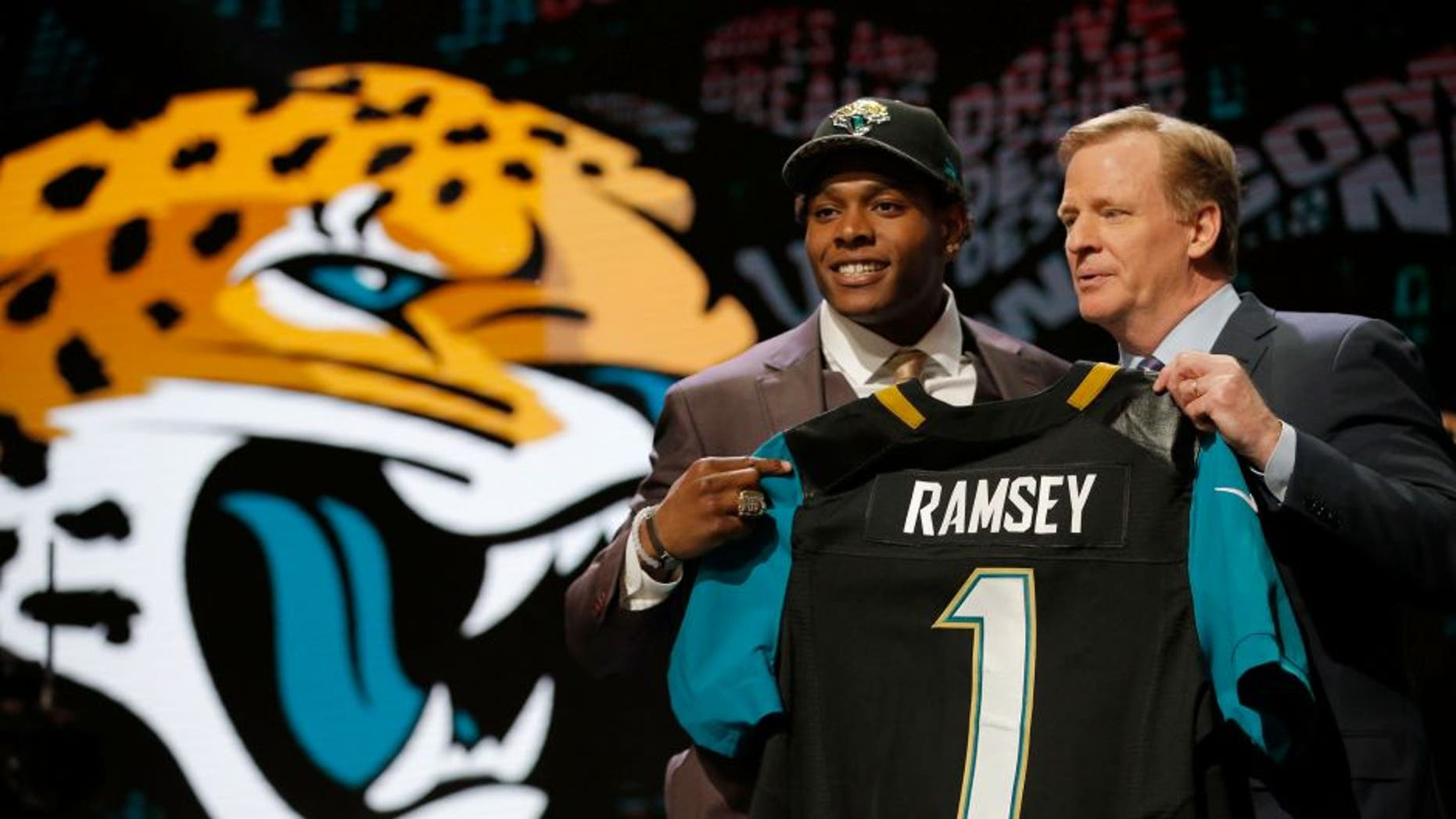 CHICAGO, IL - APRIL 28: (L-R) Jalen Ramsey of the Florida State Seminoles holds up a jersey with NFL Commissioner Roger Goodell after being picked #5 overall by the Jacksonville Jaguarsduring the first round of the 2016 NFL Draft at the Auditorium Theatre of Roosevelt University on April 28, 2016 in Chicago, Illinois. (Photo by Jon Durr/Getty Images)