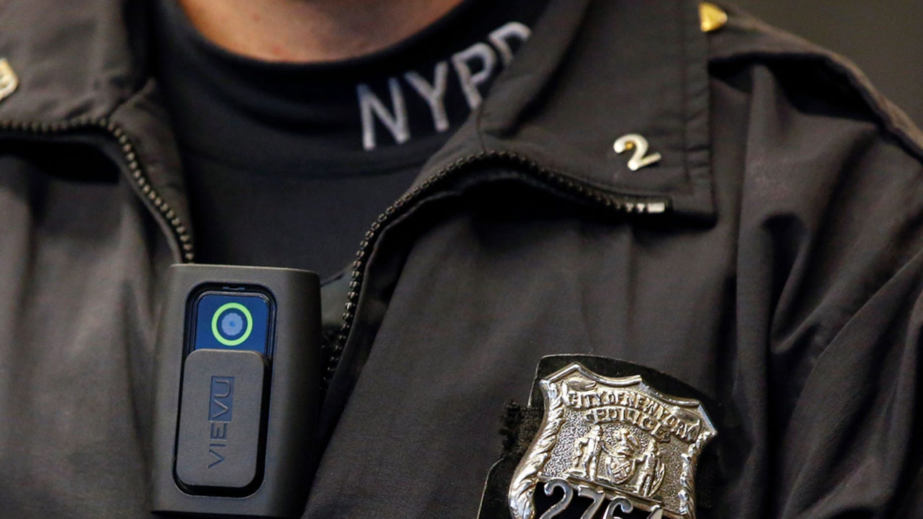 FILE PHOTO - A police body camera is seen on an officer during a news conference on the pilot program of body cameras involving 60 NYPD officers dubbed 'Big Brother' at the NYPD police academy in the Queens borough of New York, December 3, 2014.  REUTERS/Shannon Stapleton/File Photo - RTX2Z30U