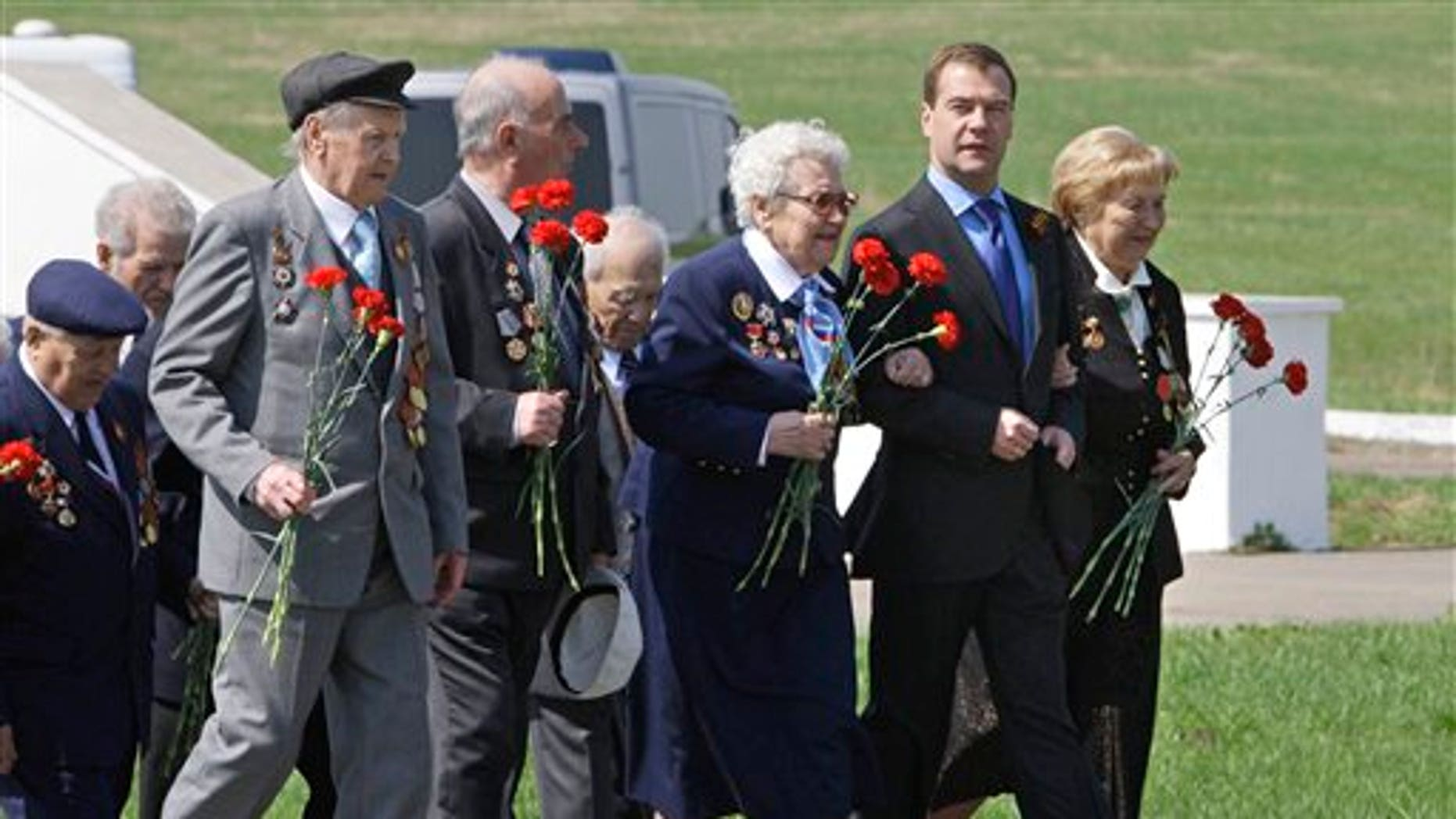 May 7: Russian President Dmitry Medvedev, second right, walks with World War II veterans to lay flowers at the monument to Soviet soldiers killed fighting Nazi troops in Nov. 1941, near Volokolamsk, 62.5 miles west of Moscow. Russia will celebrate its victory in WWII on May 9.
