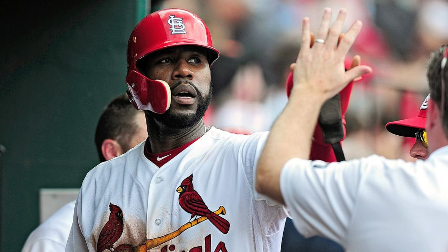 ST. LOUIS, MO - MAY 7: Jason Heyward #22 of the St. Louis Cardinals is congratulated by teammates after scoring against the Chicago Cubs during the sixth inning at Busch Stadium on May 7, 2015 in St. Louis, Missouri. (Photo by Jeff Curry/Getty Images)