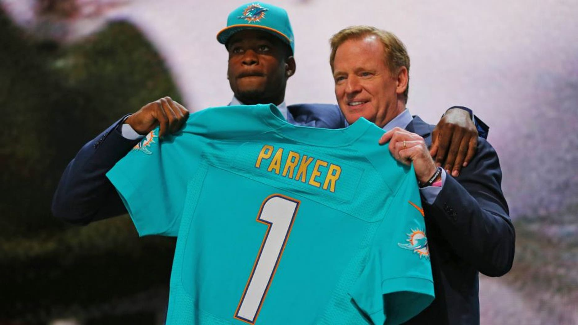 Apr 30, 2015; Chicago, IL, USA; DeVante Parker (Louisville) poses for a photo with NFL commissioner Roger Goodell after being selected as the number 14th overall pick to the Miami Dolphins in the first round of the 2015 NFL Draft at the Auditorium Theatre of Roosevelt University. Mandatory Credit: Dennis Wierzbicki-USA TODAY Sports