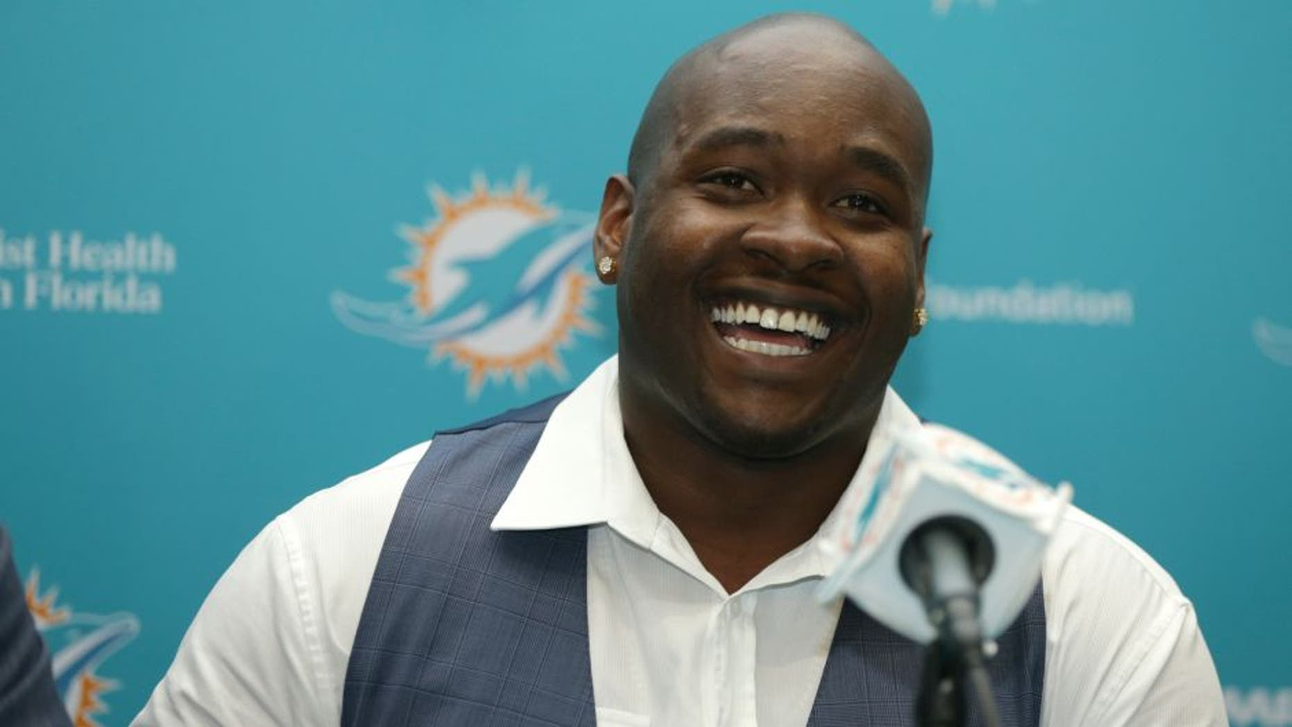 FILE - In this April 29, 2016, file photo, top Miami Dolphins draft pick Laremy Tunsil smiles during a news conference, in Davie, Fla. Tunsil and the Dolphins were quick to agree on his value in the wake of his NFL draft freefall. The offensive lineman from Ole Miss signed his rookie contract before joining the Dolphins' rookie minicamp which began Friday, May 6, 2016. (AP Photo/Lynne Sladky)