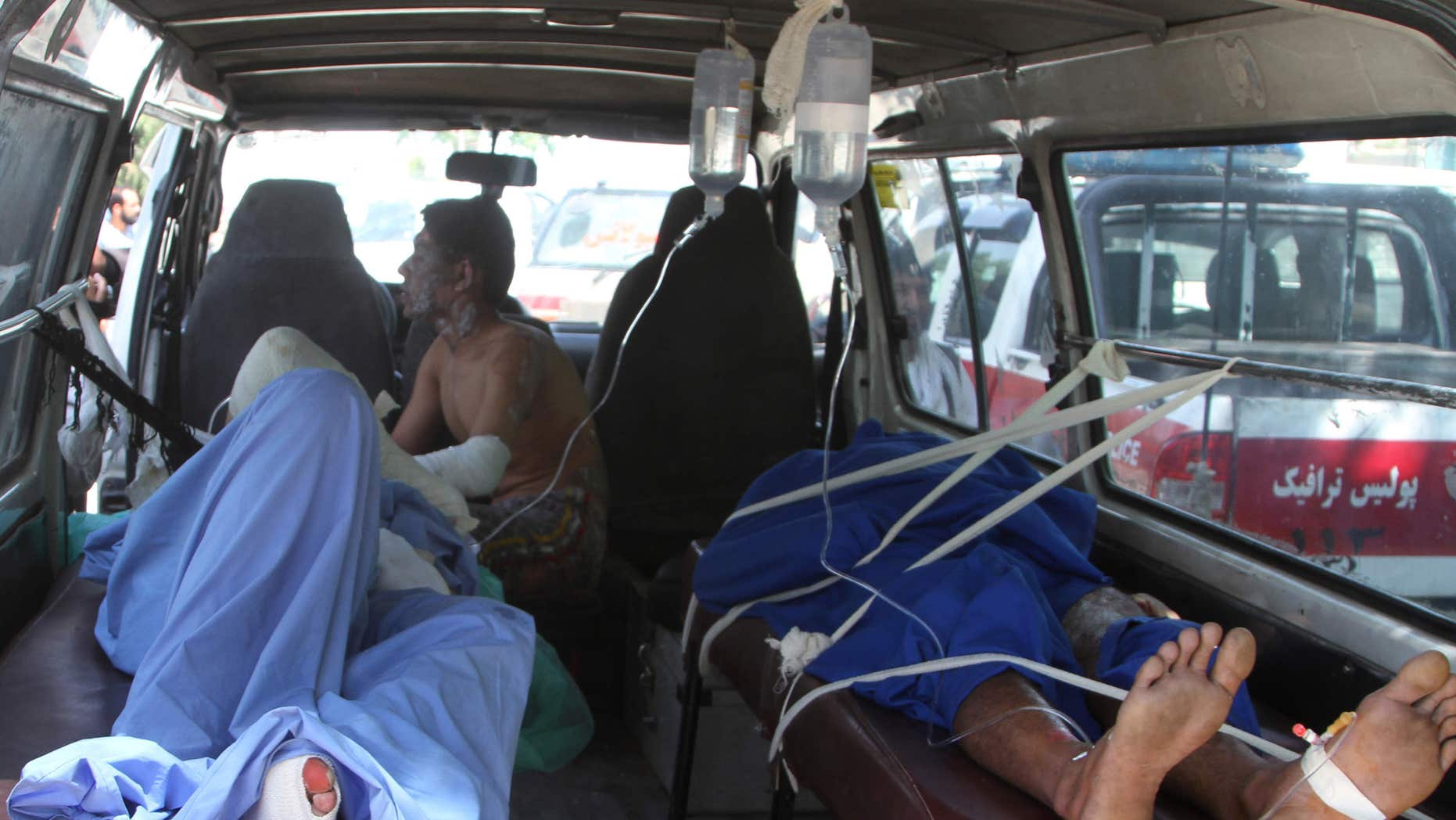 May 8, 2016: Injured Afghan men lie in an ambulance after an accident on the main highway linking the capital, Kabul, to the southern city of Kandahar, in Ghazni province eastern of Kabul, Afghanistan.