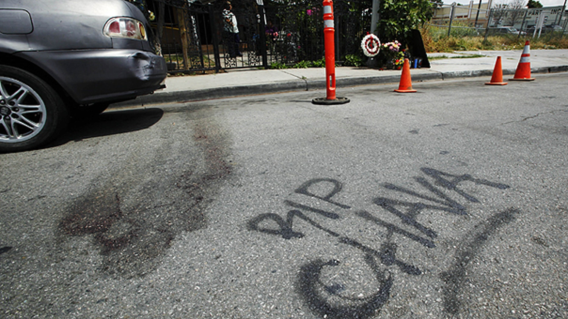 May 8: Blood stains the pavement, along with a painted 'RIP Chava' memorial and one on the sidewalk, in the street at the scene where a man shot and killed his girlfriend and two 5-year-old twins, before turning the gun on himself in a murder-suicide inside an SUV that was witnessed by three other children.